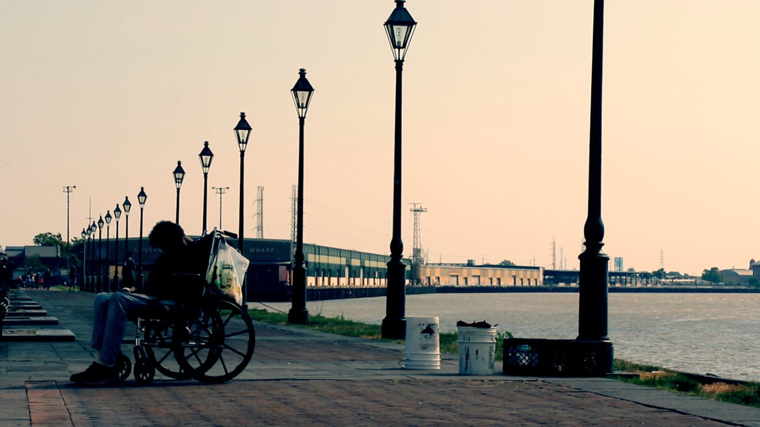 The+gas+light+district+in+New+Orleans,+a+sillouette+of+a+wheelchair+rider+waiting.jpeg
