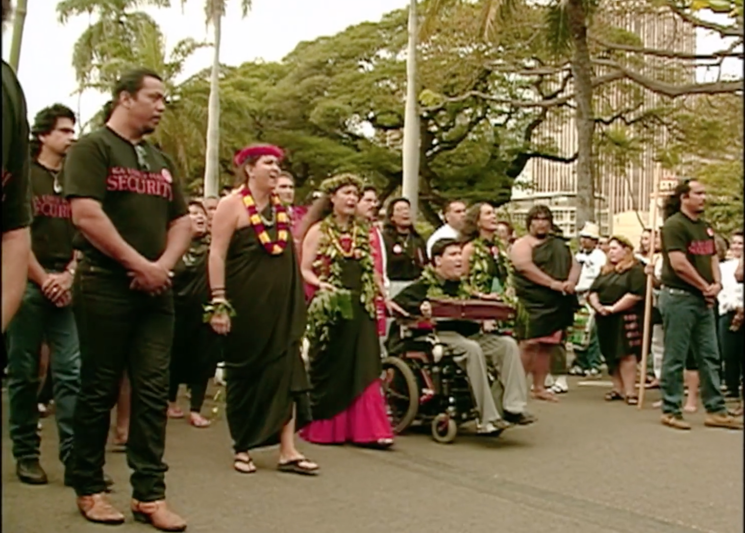 A group of activists march in Honolulu, lead by Kanalu Young.