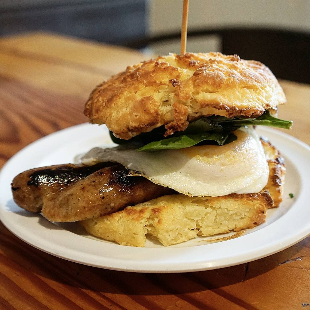 Buttermilk Biscuit with Apple Chicken Sausage, Beecher's Flagship White Cheddar, Spinach, Stone Ground Mustard Aioli, Apple Butter, & Fried Egg
