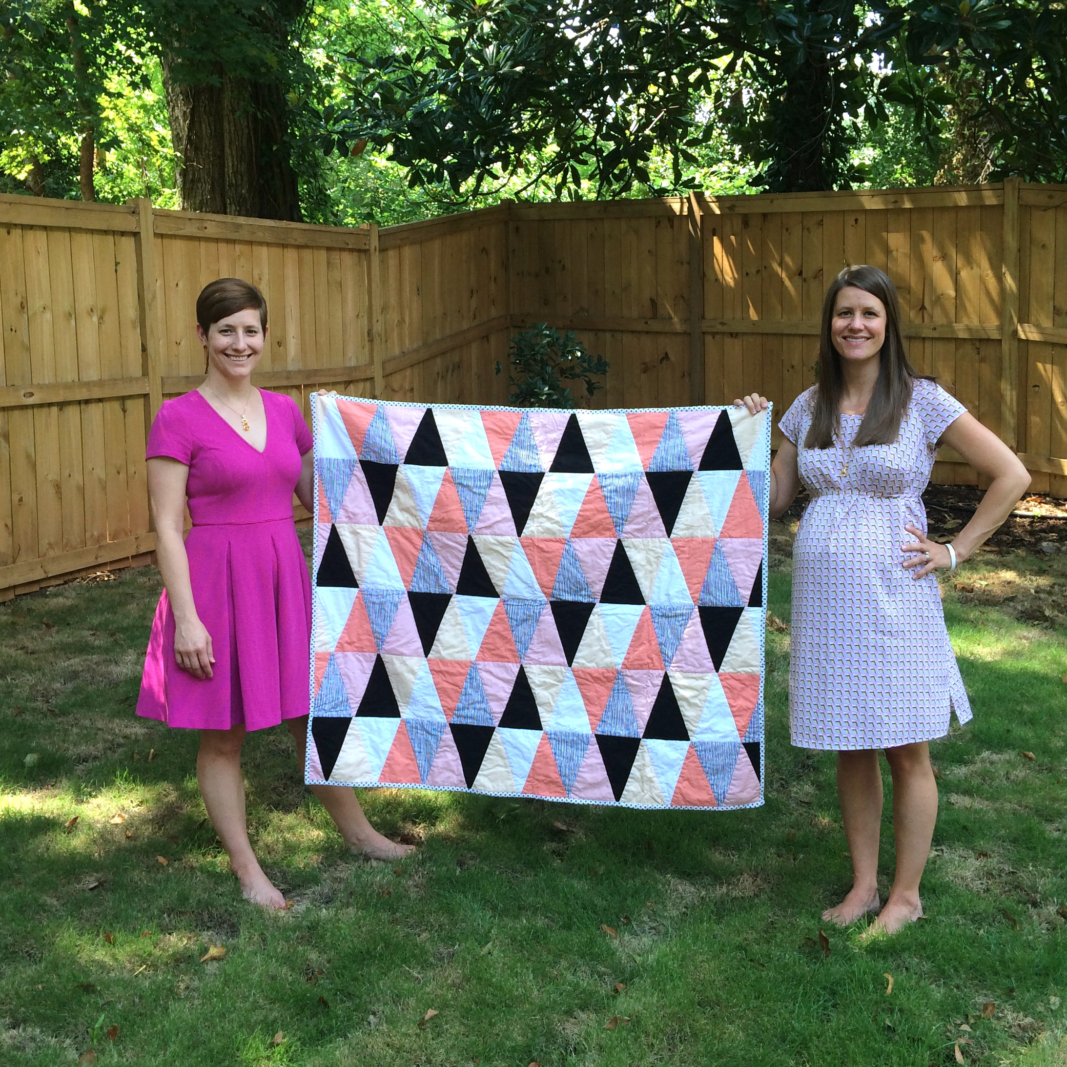 Me and my sister Kate holding my first quilt