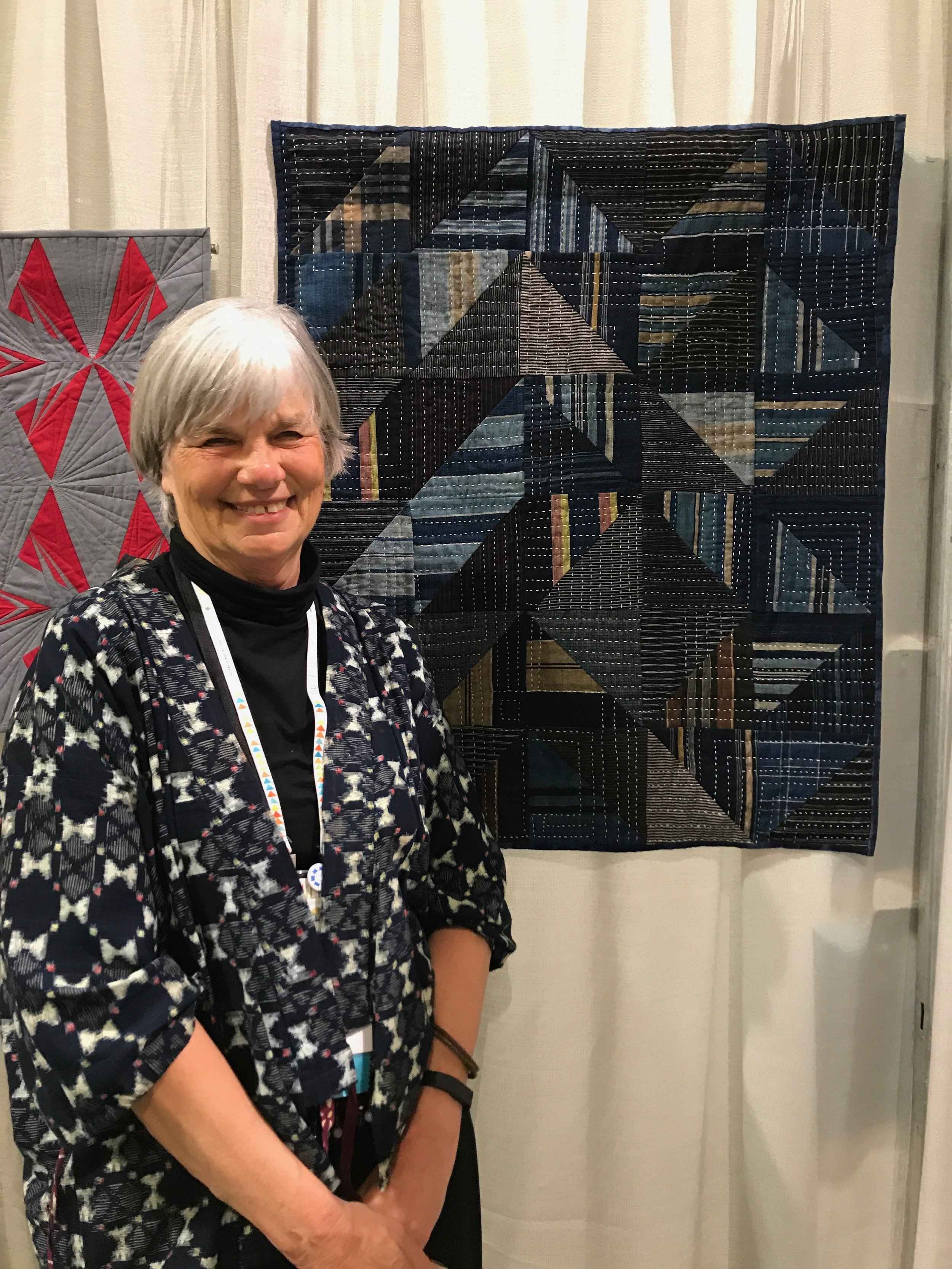 "Merikay Waldvogel and her quilt ""Japan Boro on My Mind"""