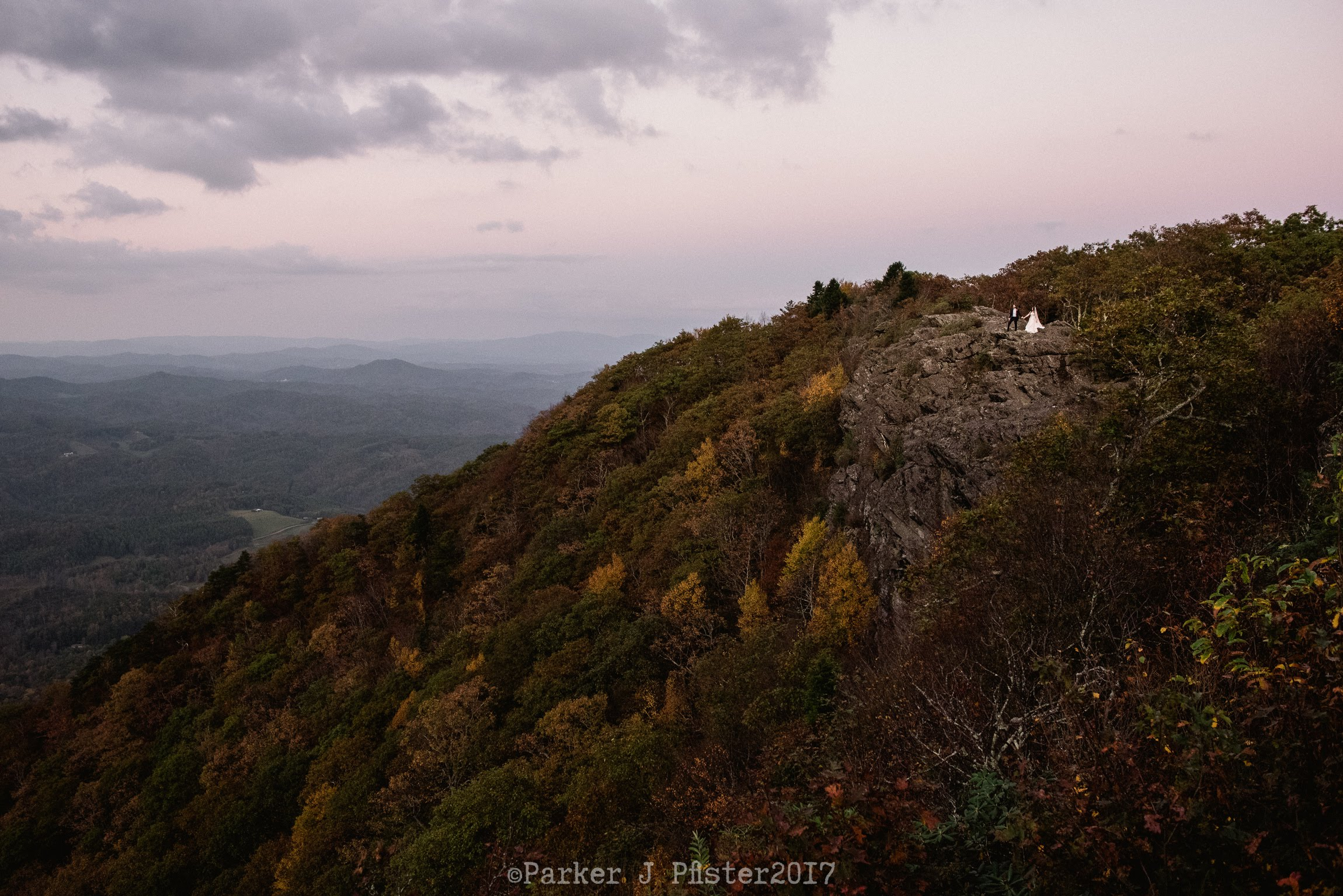 Mountain range with fall colors at sunset