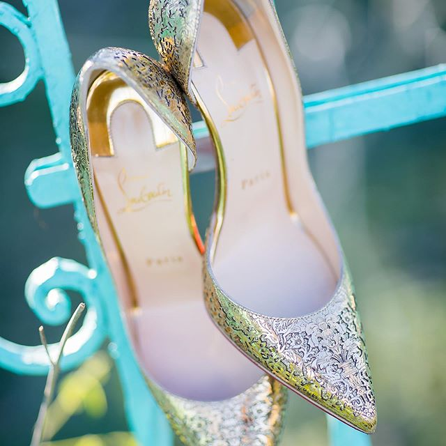 Who's ready for a little wedding shoe inspiration today?⁠⠀ We loooooove our bride', Adrianna, @ChristianLouboutinShoes.⁠⠀ Red soles⁠⠀ Laser-cut⁠⠀ Metallic gold⁠⠀ PERFECTION!⁠⠀ ⁠⠀ Photographer @dustinfinkelsteinphotography⁠⠀ Venue @villastclair⁠⠀ Planner/Designer @villastclair⁠⠀ .⁠⠀ .⁠⠀ .⁠⠀ #TuesdayShoesday #FashionInspiration #bride #happy #happiness #unforgettable #love #forever #redsoles #weddingphotography #weddinggown #weddingdress #redsoleshoe #redsoleweddingshoe #redsoleweddingshoes #luxurywedding #luxurytexaswedding #luxuryaustinwedding  #weddingday #weddingplanner #weddingvenue #AustinWedding #TexasWedding #luxuryaustinweddingvenue #luxurytexasweddingvenue #luxuryaustinweddinggplanner #luxurytexasweddingplanner #austinweddingvenue #austinweddingplanner #austinweddingflorist