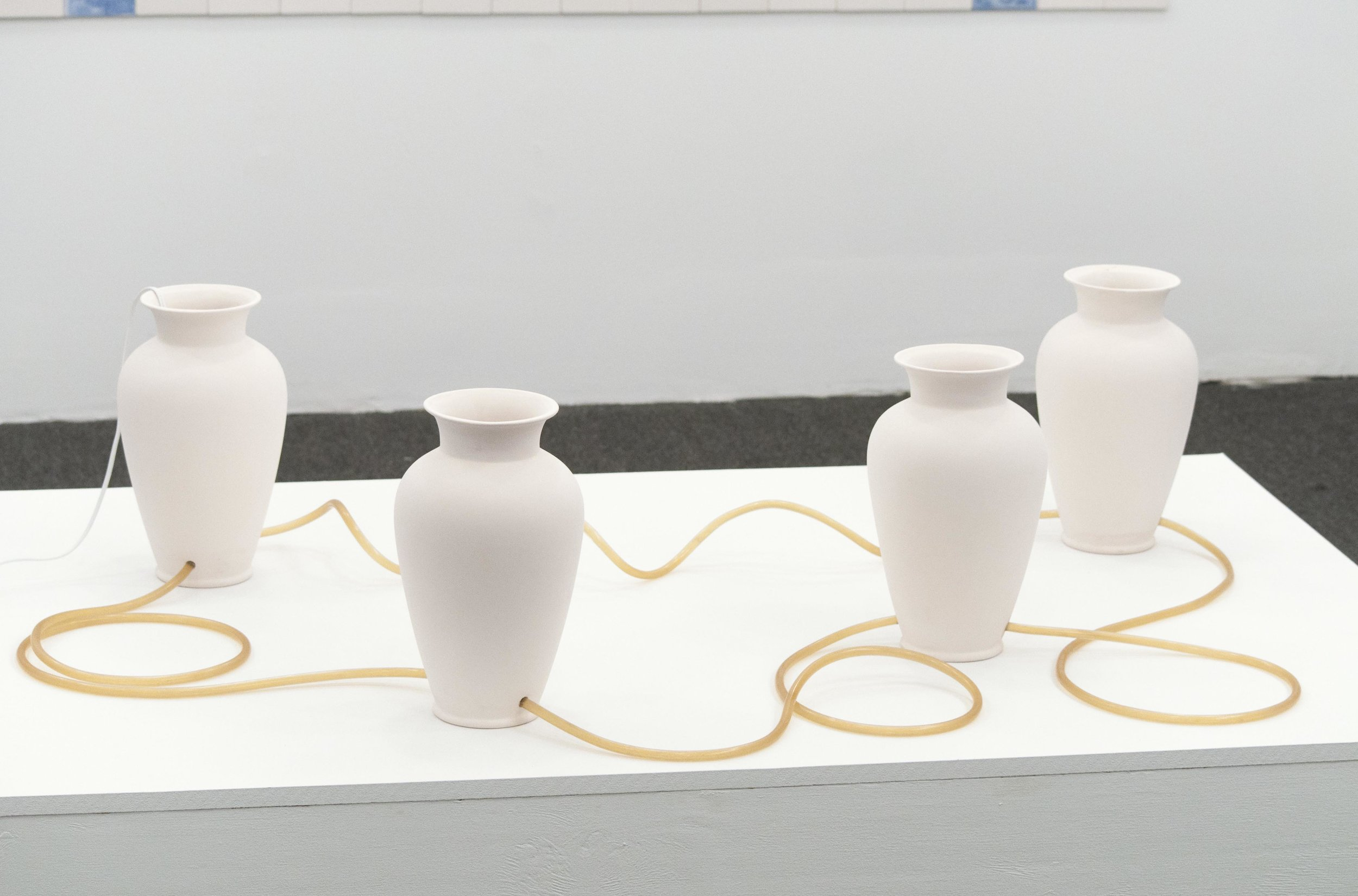 "Title: Untitled (Self-conditioning) Artist: Tiffany Jaeyeon Shin Year: 2017 Medium: Bisque, tube, motor, Hyangyak Dimensions: Each vase 12"" x 8"" x 8"" Price: $4000"