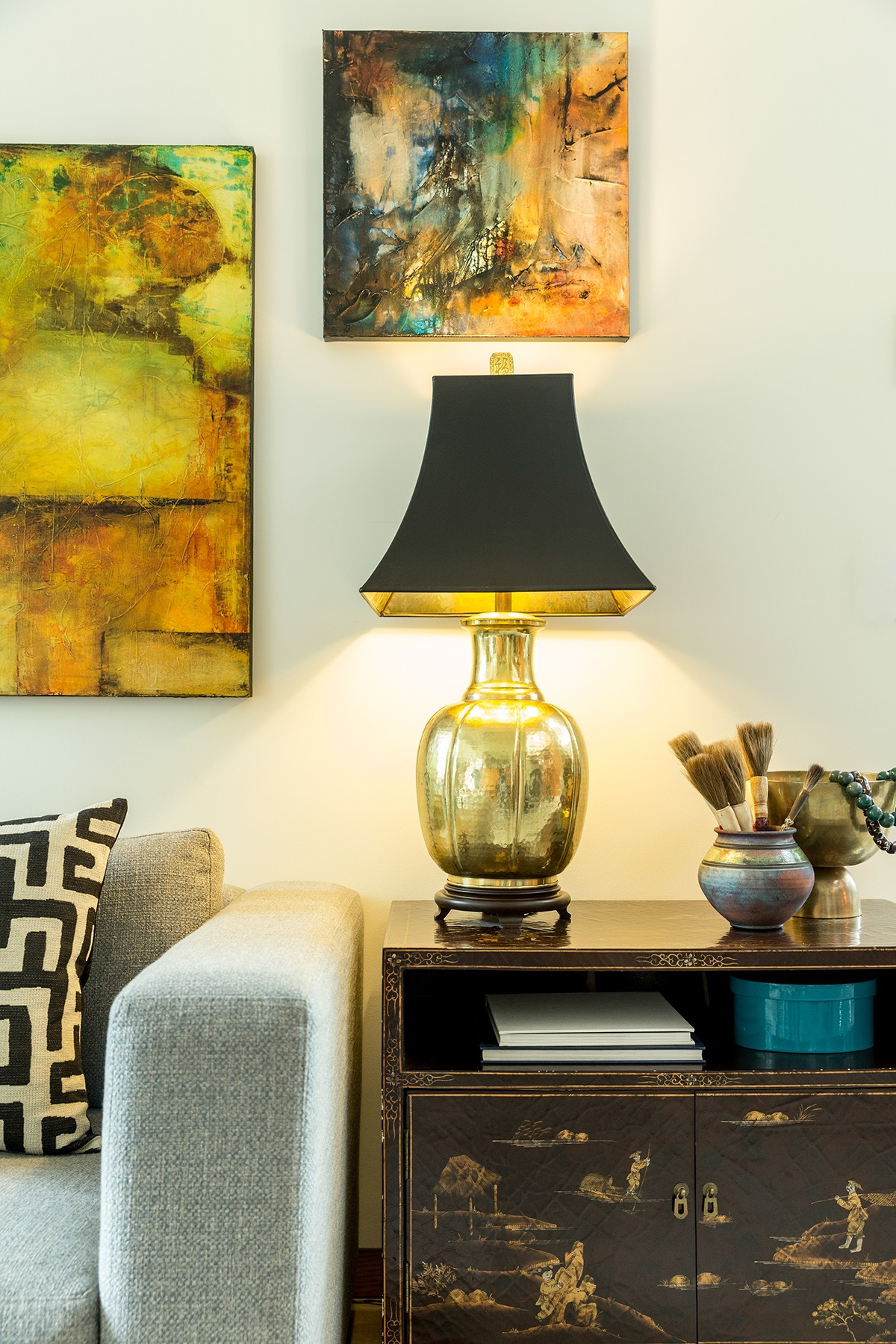 These original paintings by  Chris Foster  are some of my favorites.  They weren't cheap, but I adore them. Conversely, I picked up this table lamp at a consignment shop for $25.  Photo by John Valls.