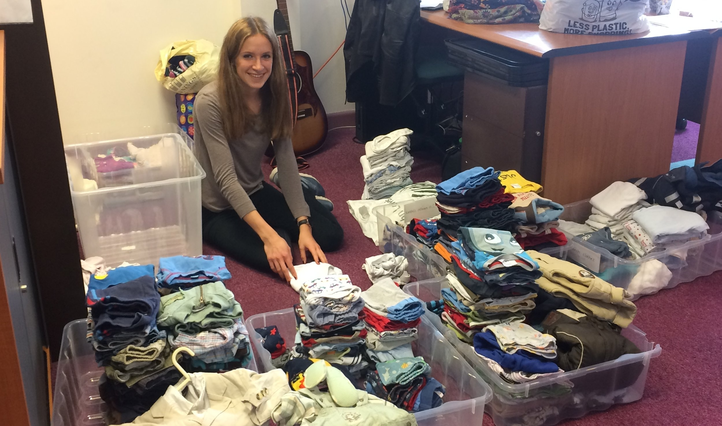 Salome (one of our new interns) helping to sort out clothes for the Syrian families.