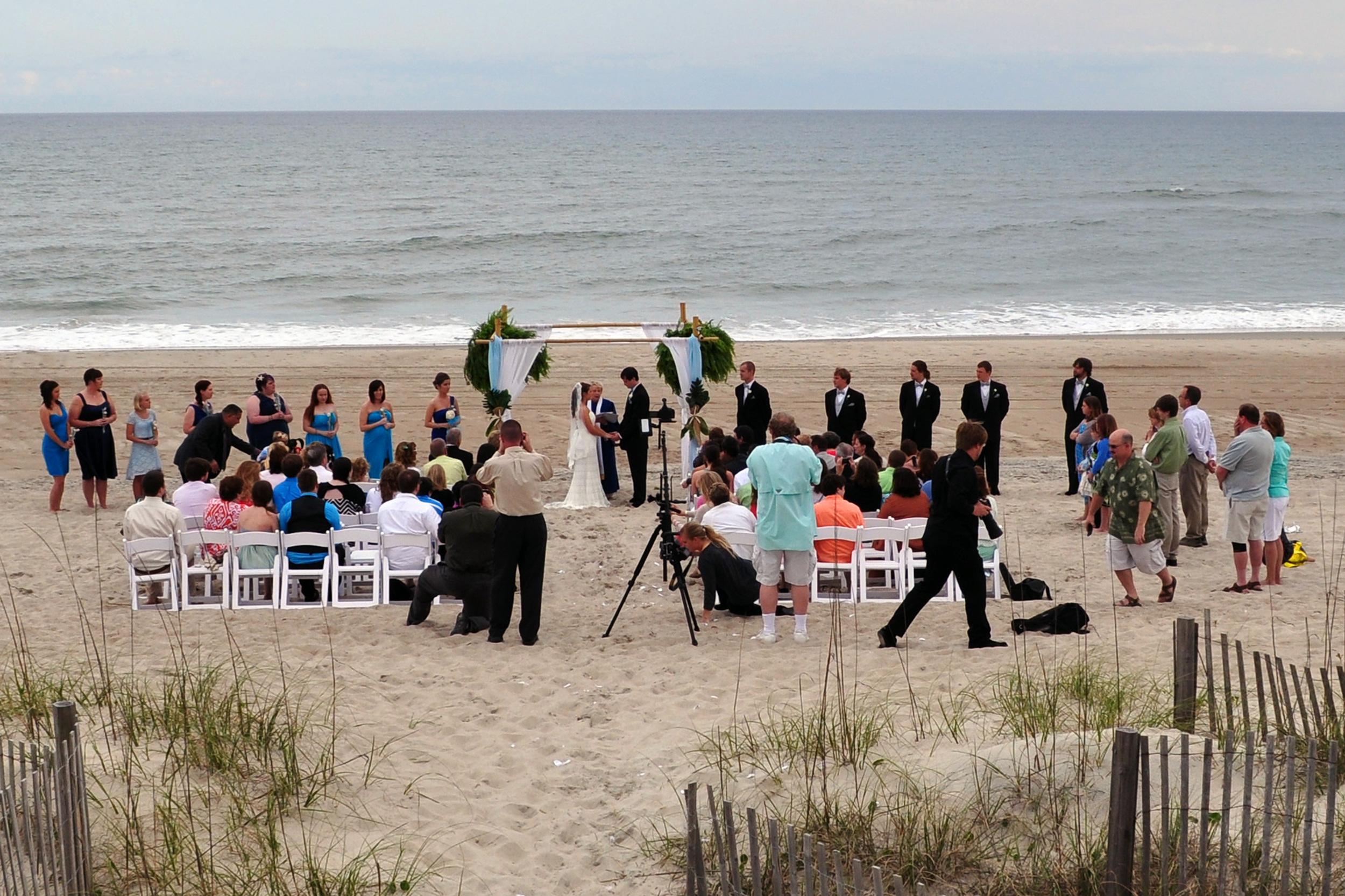 Reverend Beth officiates a beach wedding