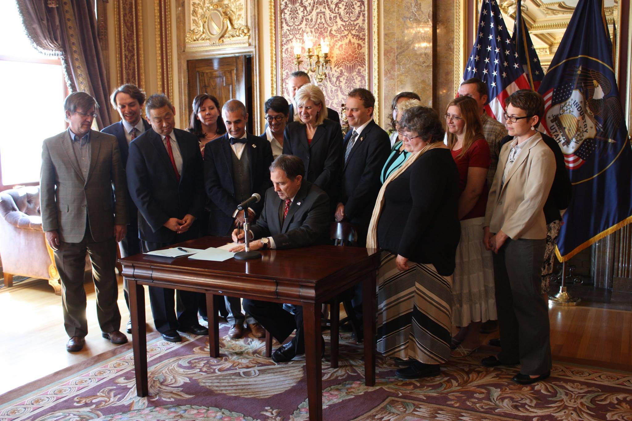 At the signing ceremony with Governor Herbert, current and former teachers of the year, Reps. Marie Poulson and Joel Briscoe, and others at the signing ceremony for HB200 and HB201.