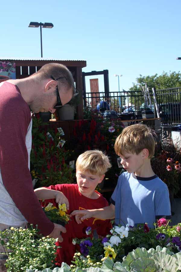 Kids helping choose plants