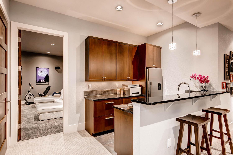 14681 Zuni St Broomfield CO-large-029-22-Lower Level Family Room Bar-1500x1000-72dpi.jpg