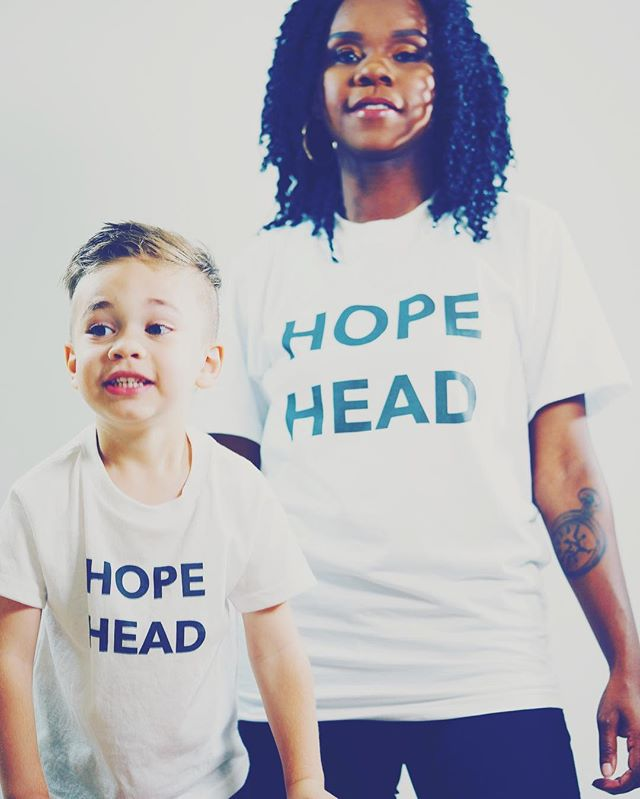 "Step back and let the kids lead sometimes. They see the world from a much needed and beautiful perspective. This is Niko and I with shirts of his original phrase ""Hope Head"" 💙 📸: @grh_pr  Styled by: @alicoleman"