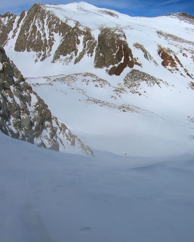 🏔 Mount Emerson, North Couloir. 🏔 a striking line from 13,000' that's hidden from view until you're right beneath it. . Strong uphill gusts and wind-affected snow made the climb intense, & the skiing technical but fun when we visited in March. . The bit of fresh made for good turns high in the alpine, and my beard was actually snow-caked when I got to the bottom. ENJOY 👁🎞💛. . @arcteryxlabrea @salomonfreeski @blackdiamond #celebratewild #liveskirepeat #salomonqst #timetoplay #rangeoflight #earnyourturns #sierranevada #couloir