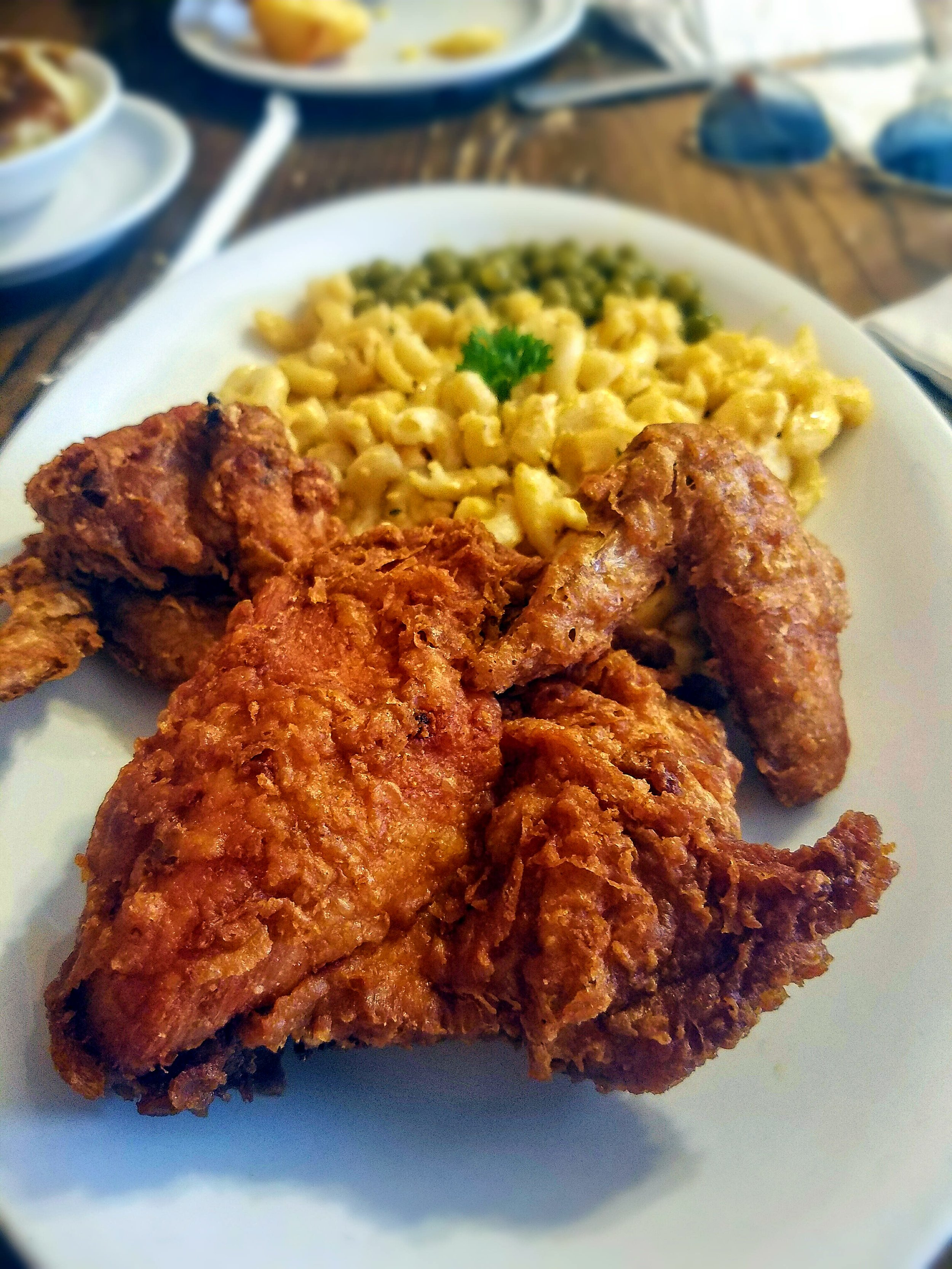 Willie Mae's Fried Chicken served with Mac & Cheese and Sweet Peas