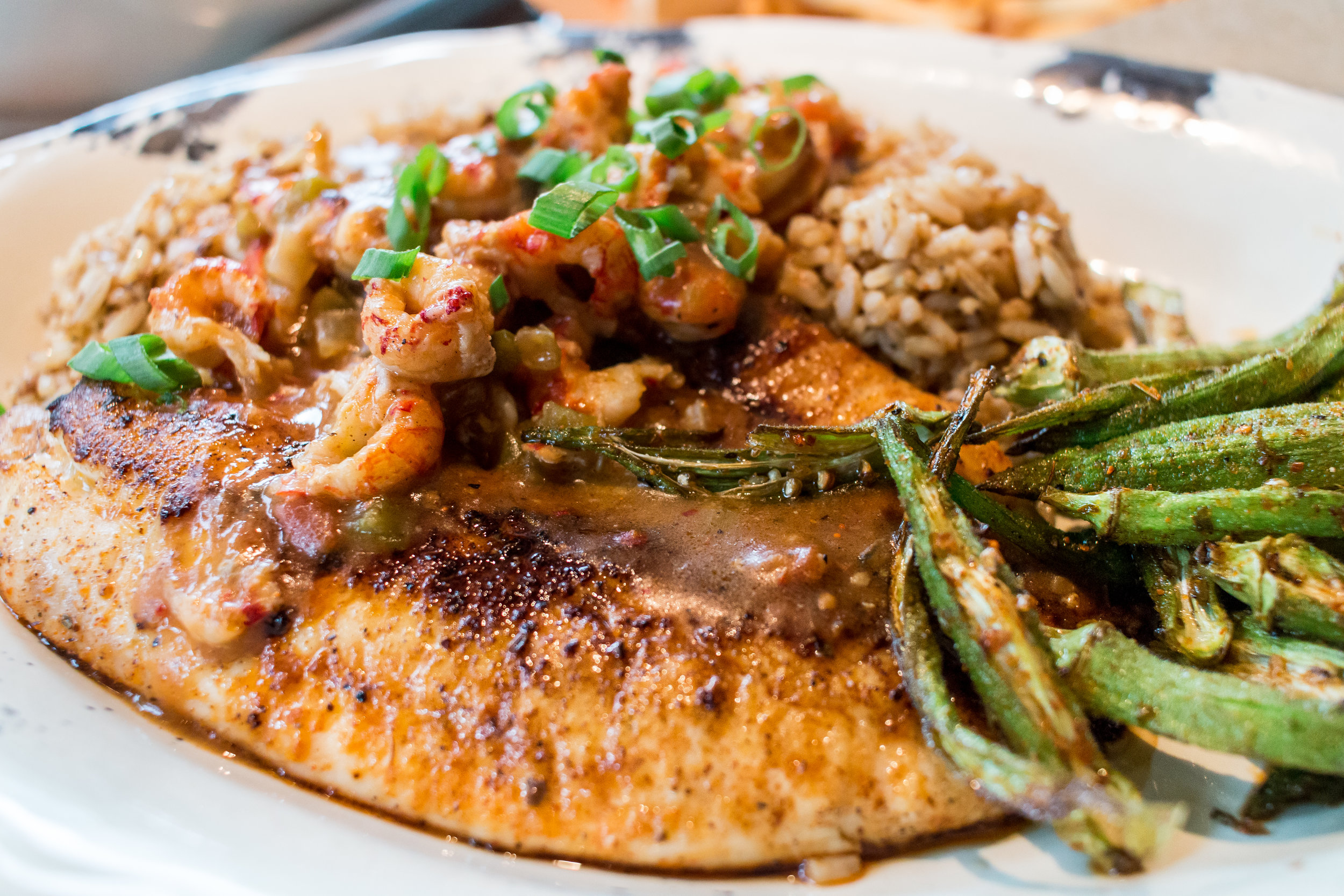 Tricky Fish- Blackened Tilapia, dirty rice, crawfish etouffee.