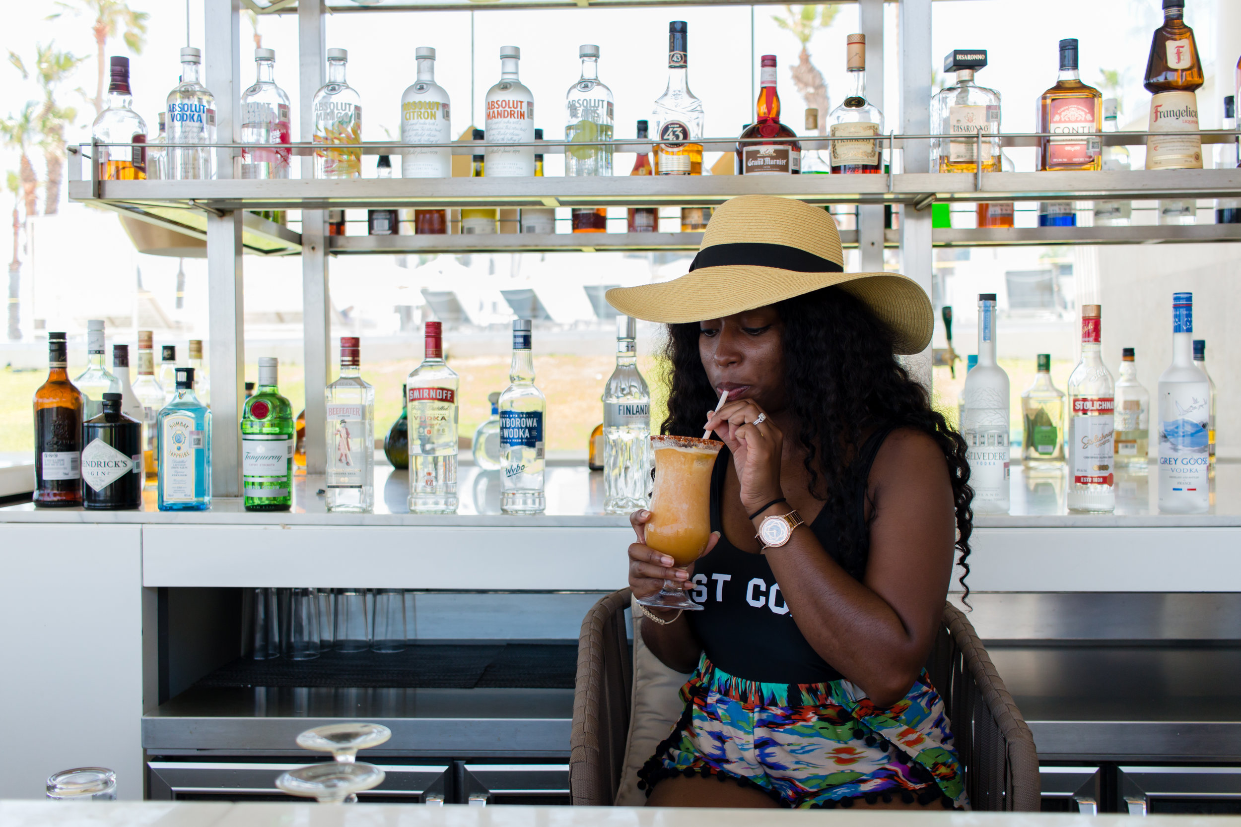 Enjoying a drink behind the bar