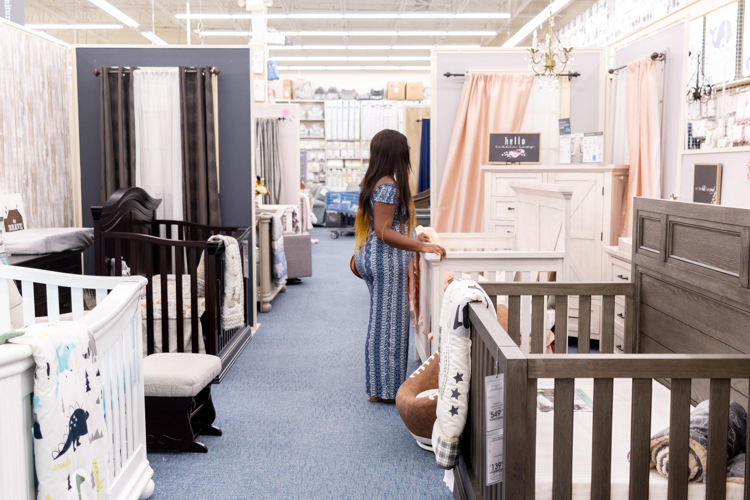 looking-at-cribs-inside-of-buy-buy-baby-registry-guide-new-moms