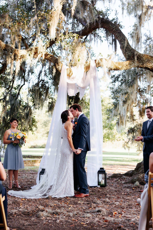 bride-groom-kiss-mcleod-plantation-charleston.JPG