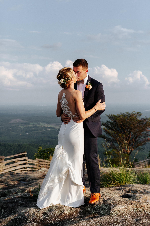 bride-groom-cliffs-glassy-kissing.JPG