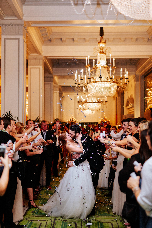 bride-groom-kiss-exit-st-anthony-hotel-san-anonio-texas.JPG