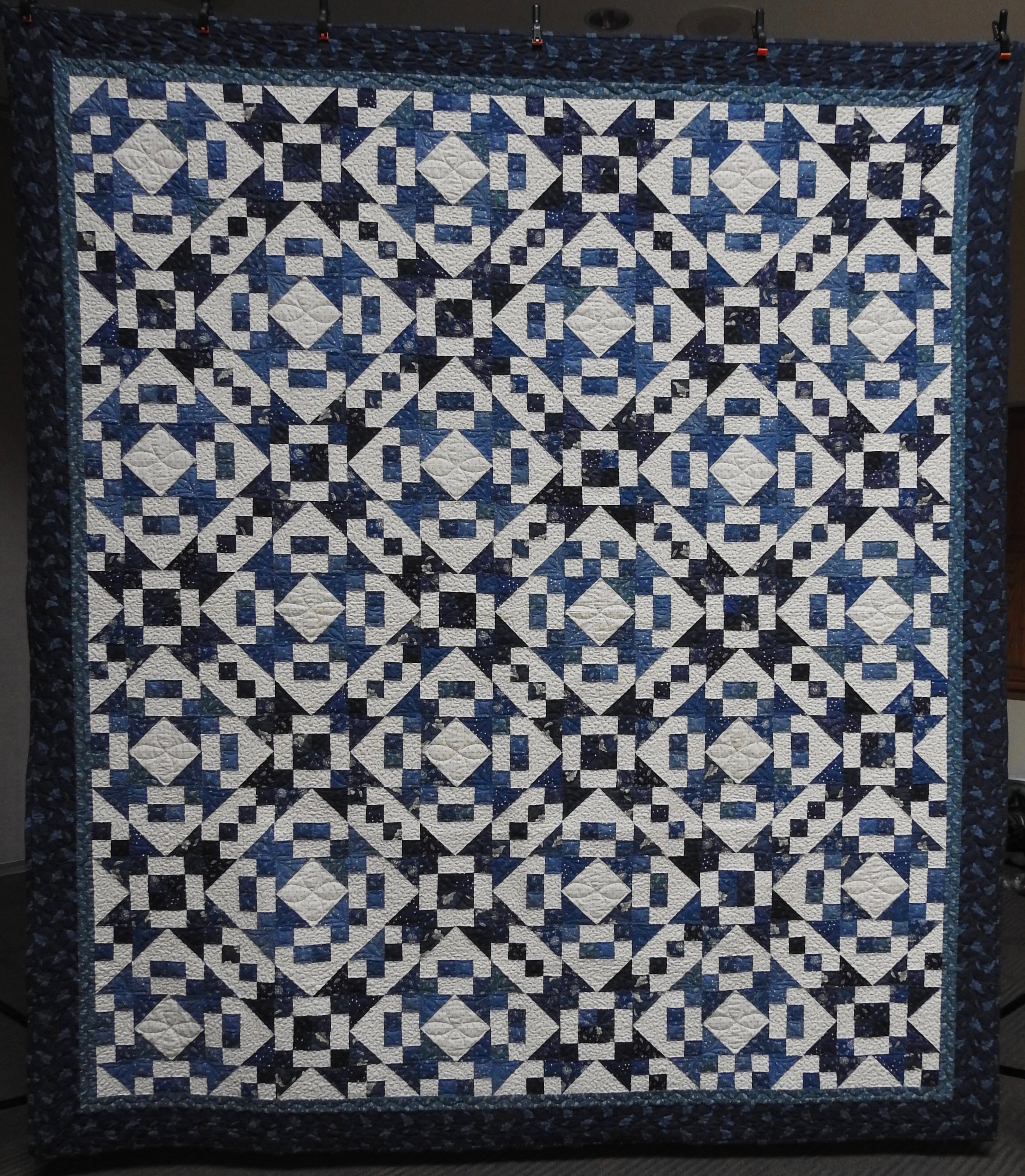 Glacial Blues, Pieced by Jean Mann Graber, Custom Machine Quilted, donated by the Cal Graber Family, 92 x 104""