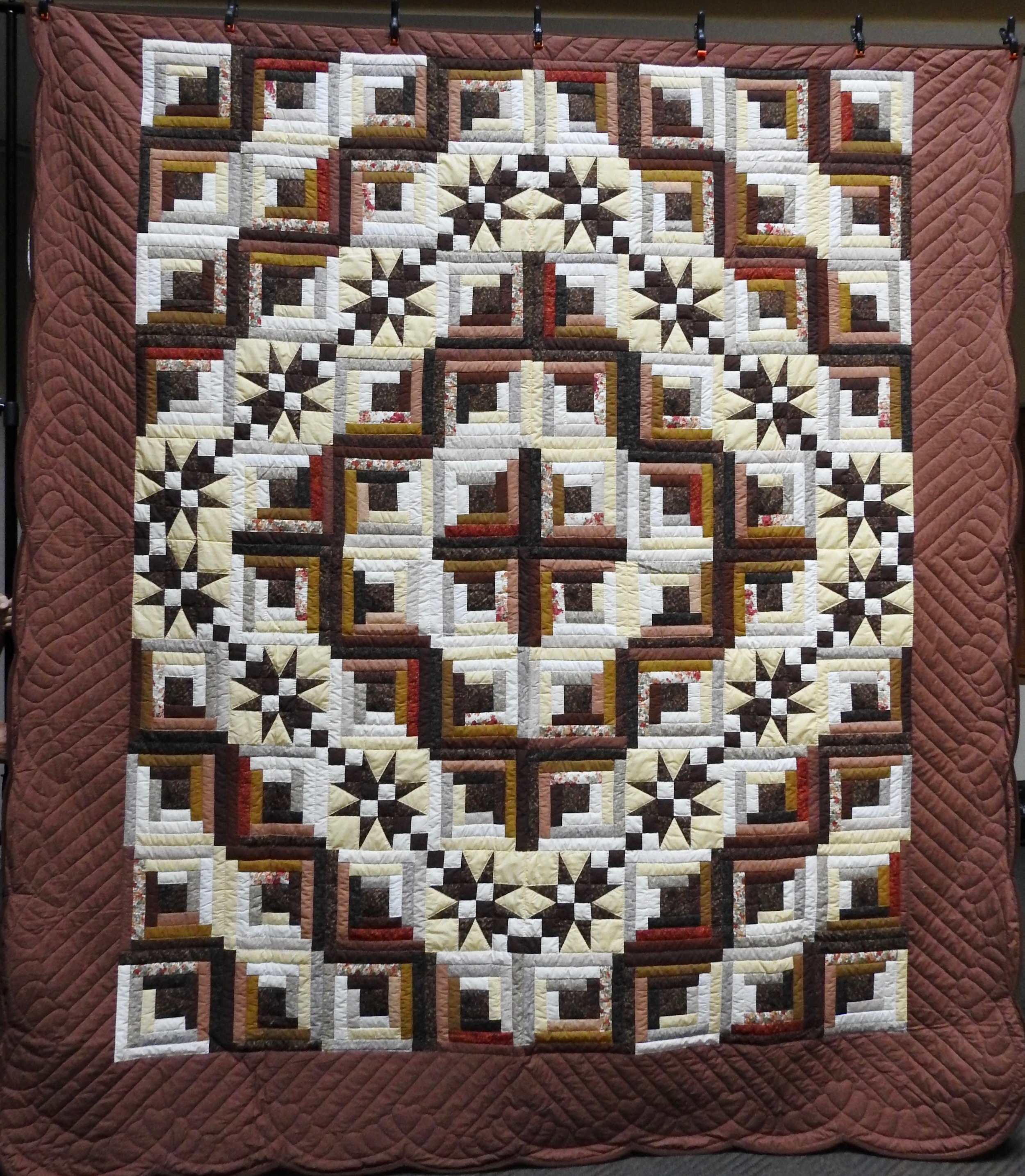Many Star Log Cabin, Pieced, Hand Quilted, donated Anonymously, 100 x 113""