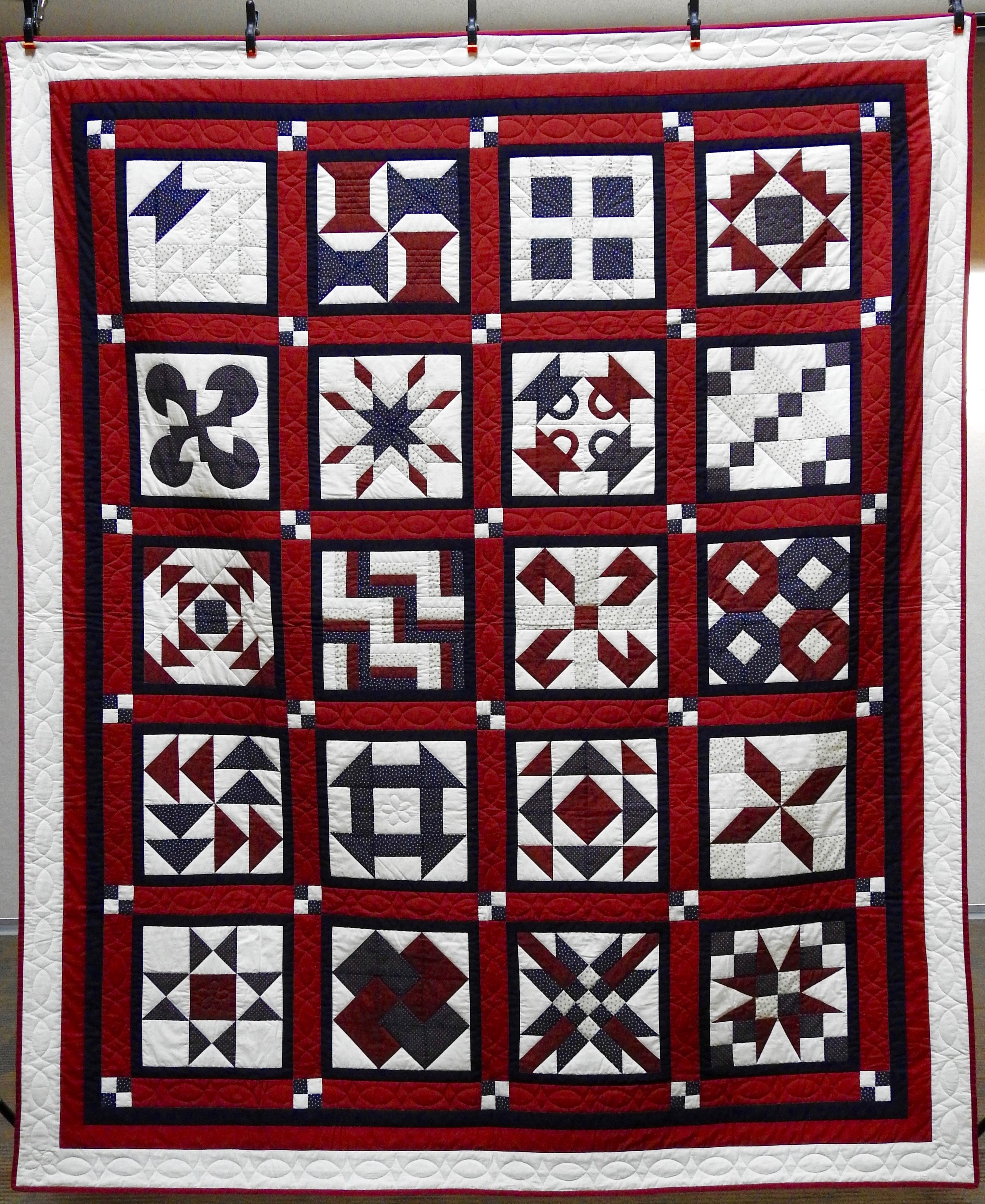 Red, White & Blue Sampler, Pieced & Hand Quilted by Isabel Leipprandt, Signed & Dated, donated by Wayne & Karen Moss, 73 x 98""
