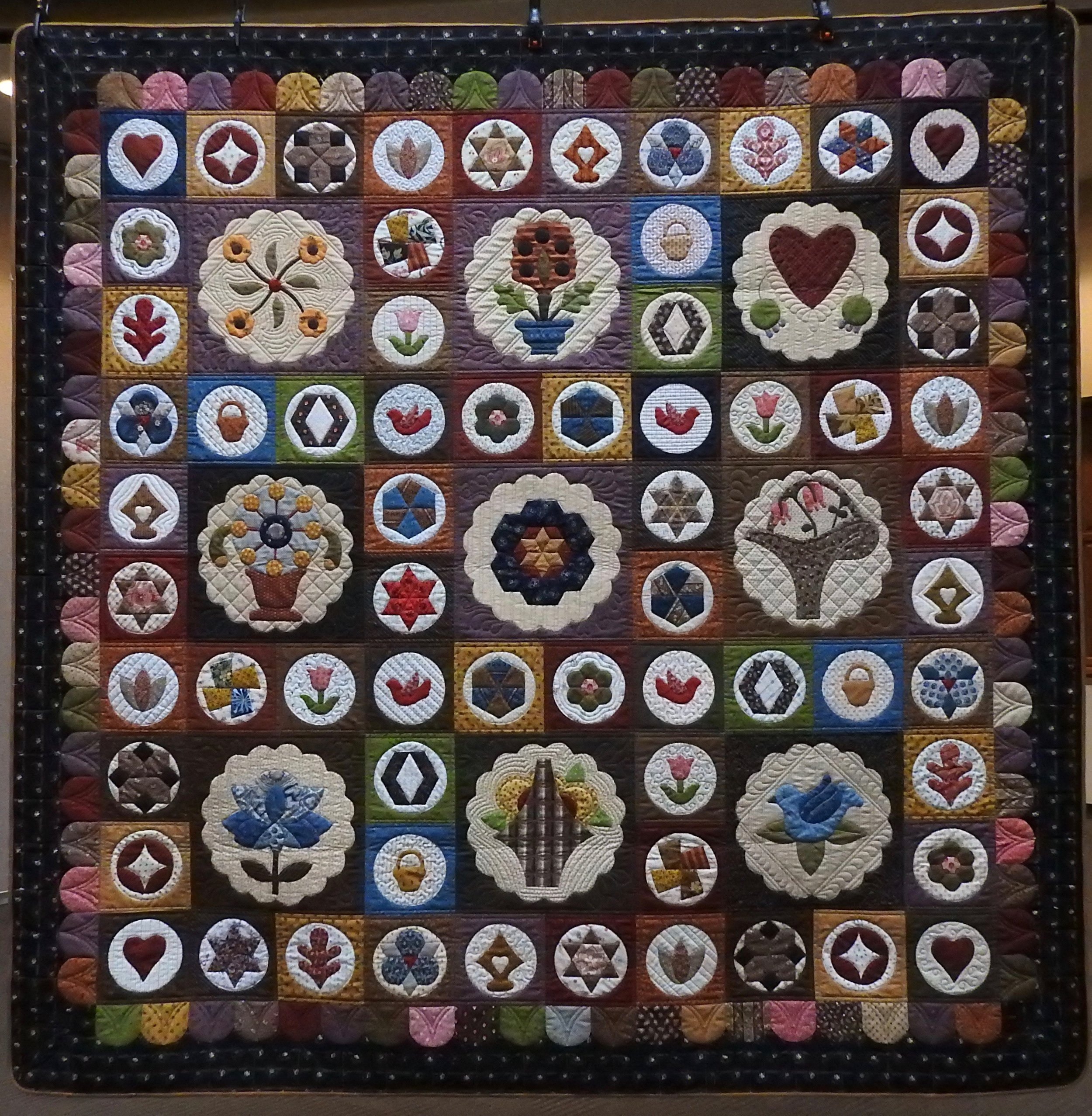"""Antique Sampler Quilt, Pieced & Appliquéd of New Fabrics by Edith Shanholt, pattern adapted from Antique Quilt by Sue Daley, Custom Machine Quilted, donated by Edith Shanholt, 72 x 72"""""""