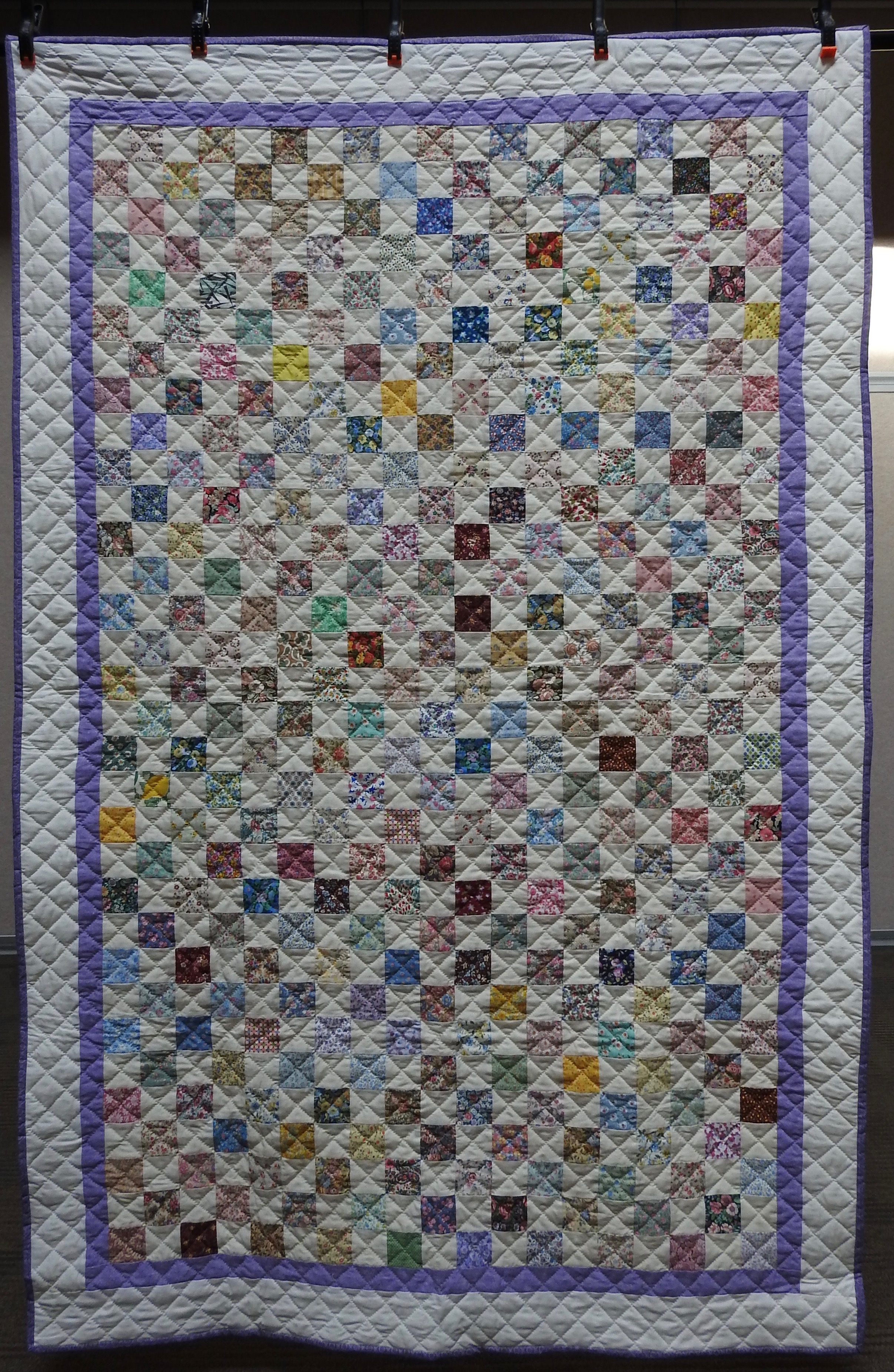 A Pastel Checkerboard, Pieced by Jean Hume Proudfoot, Hand Quilted by Evergreen Place Quilters, donated by David & Mary Anne Proudfoot, 52 x 80""