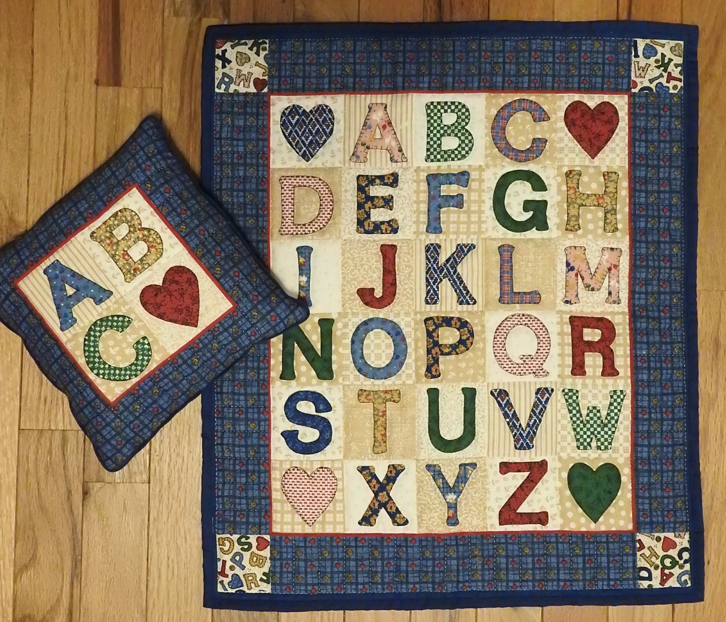 """Alphabet Doll Quilt with Pillow, Pre-printed, Hand Quilted and donated by Virginia A. Hartsough, 17 x 20"""""""
