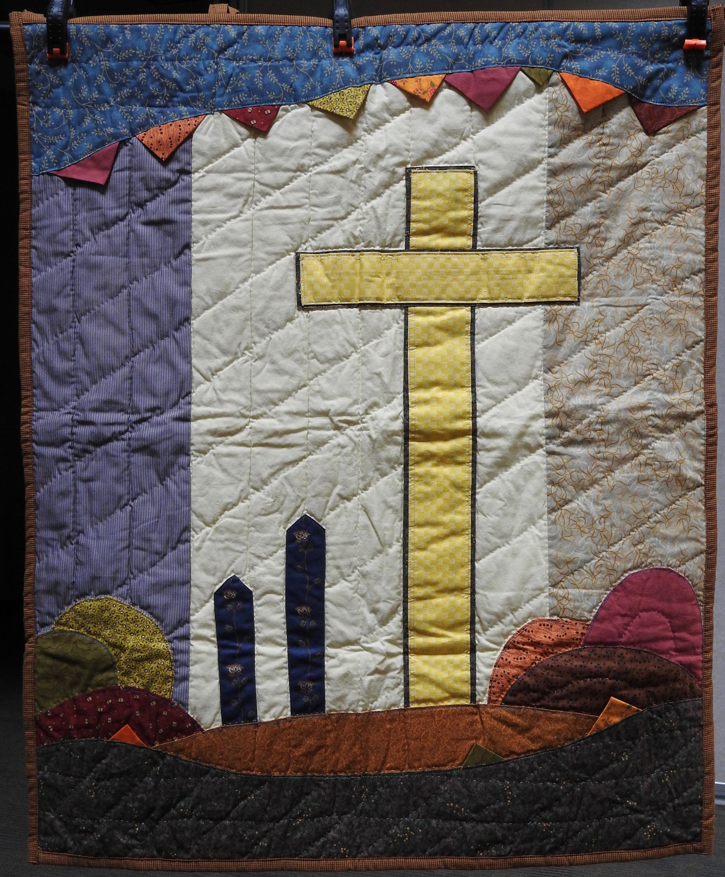 Cross in Autumn, Pieced & Appliquéd, Hand Quilted, donated by Howard-Maimi Mennonite Church, 29 x 36""