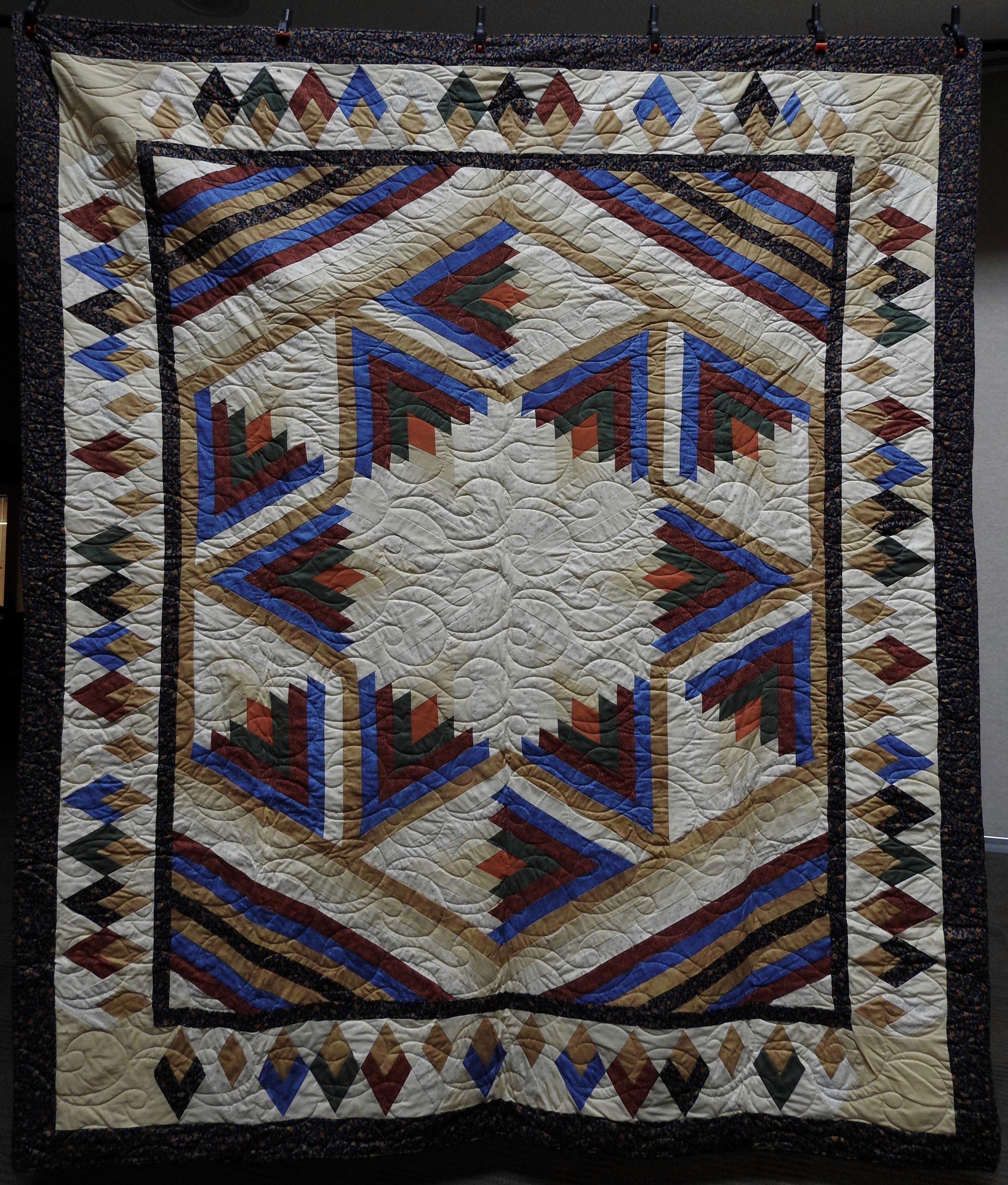 Broken Star, Pieced, Custom machine Quilted, donated by Barbara Jewett, 74 x 90