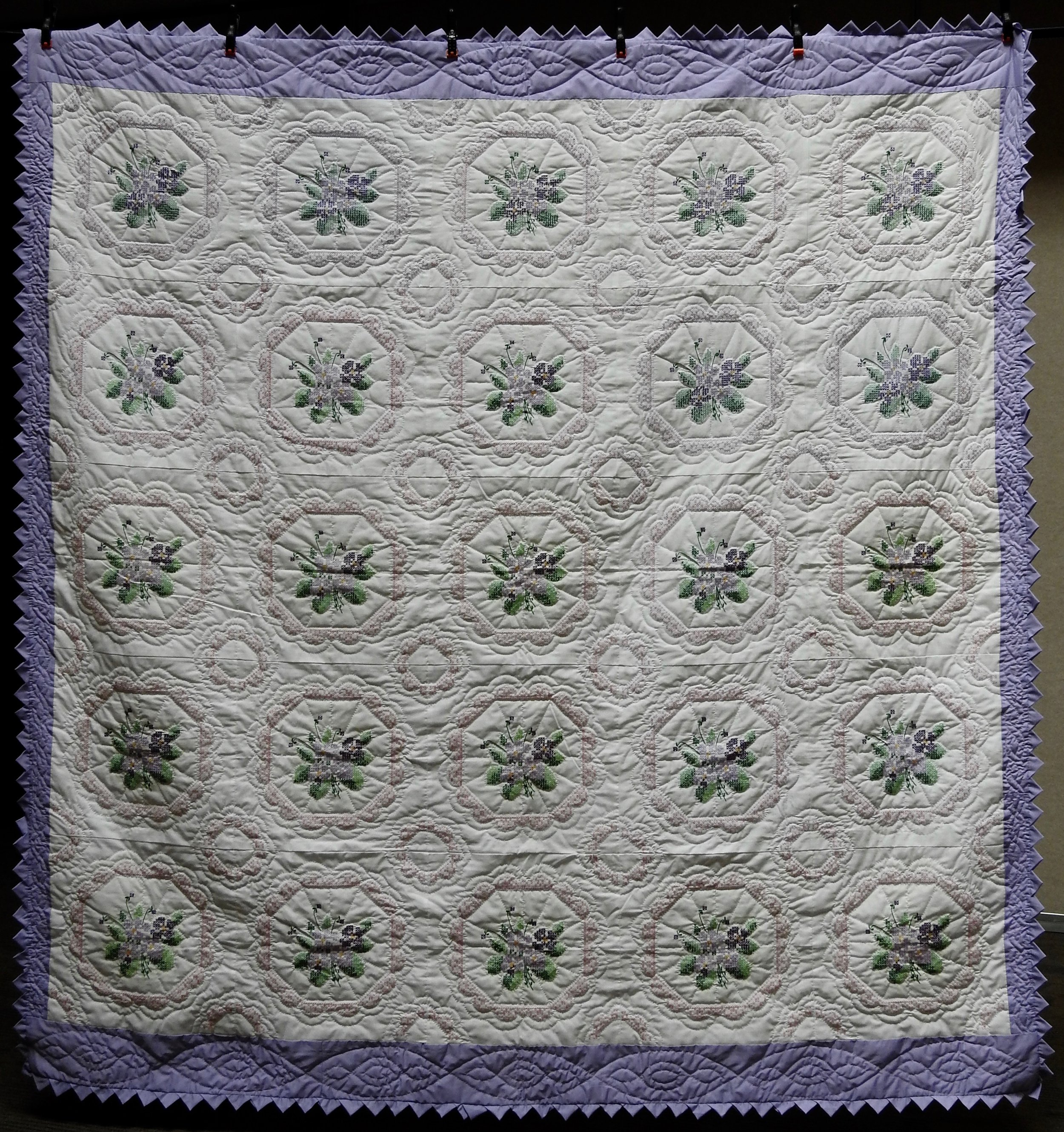 Cross Stitched Violets, Pieced, Cross Stitched, Hand Quilted, donated by Howard-Miami Mennonite Church, 89 x 95""