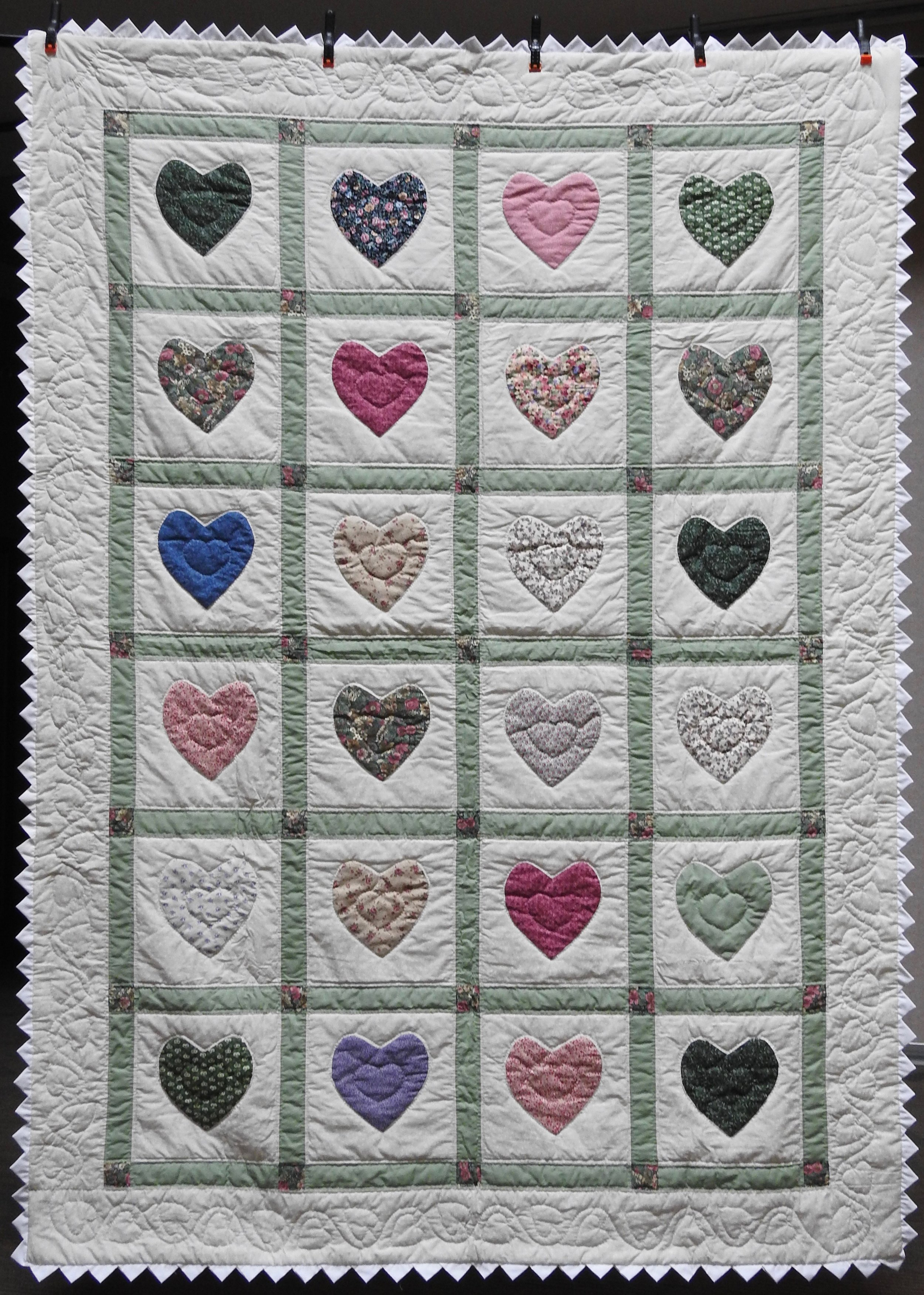 """Appliquéd Hearts, Pieced, Appliquéd, & Hand Quilted by Fern Gingerich, donated by Howard Miami Mennonite Church, 69 x 96"""""""