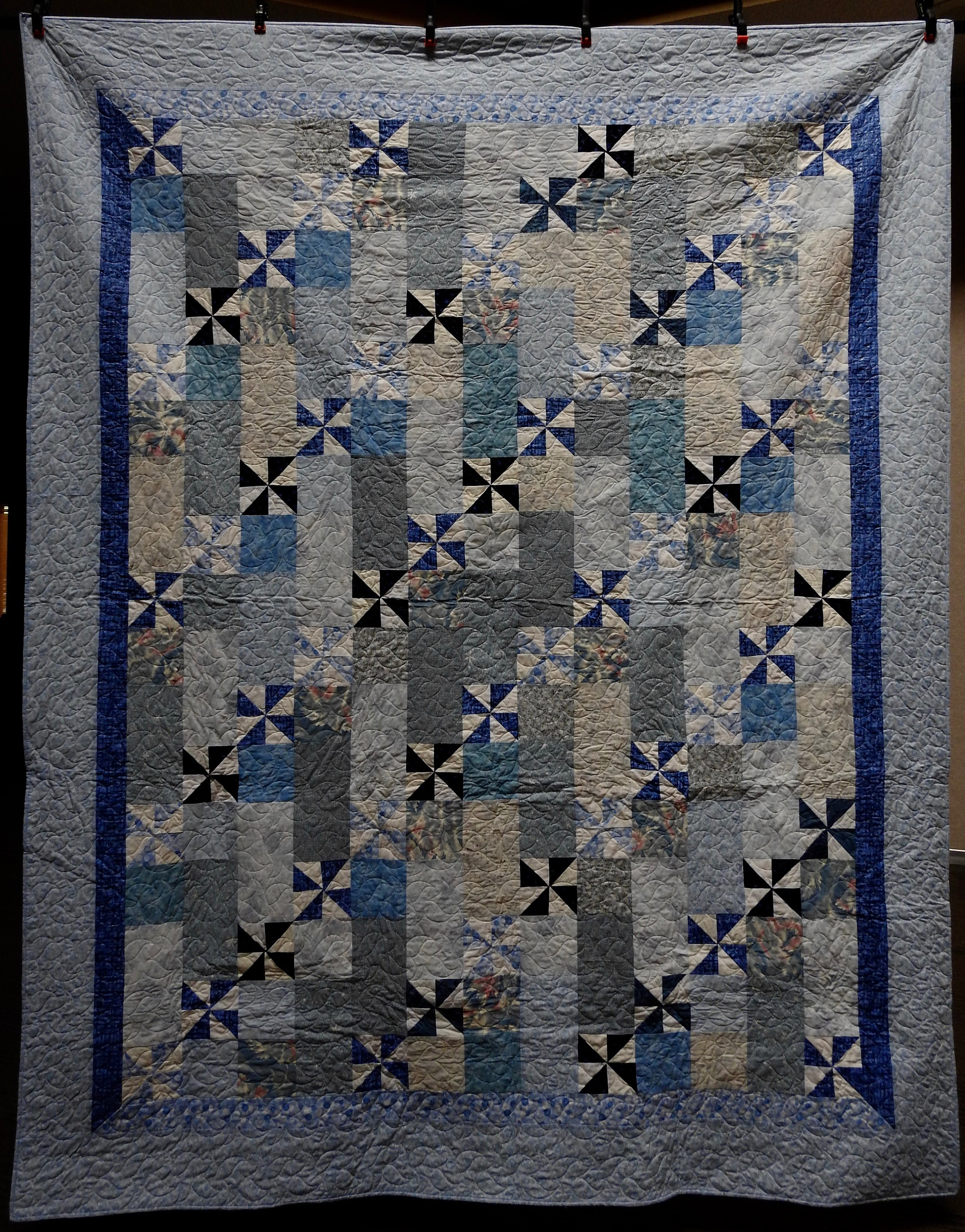 """Pinwheels Galore, Pieced by Ruby Bontreger, Edge to Edge Machine Quilted, signed & Dated, donated by First Mennonite, Middlebury, 78 x 99"""""""