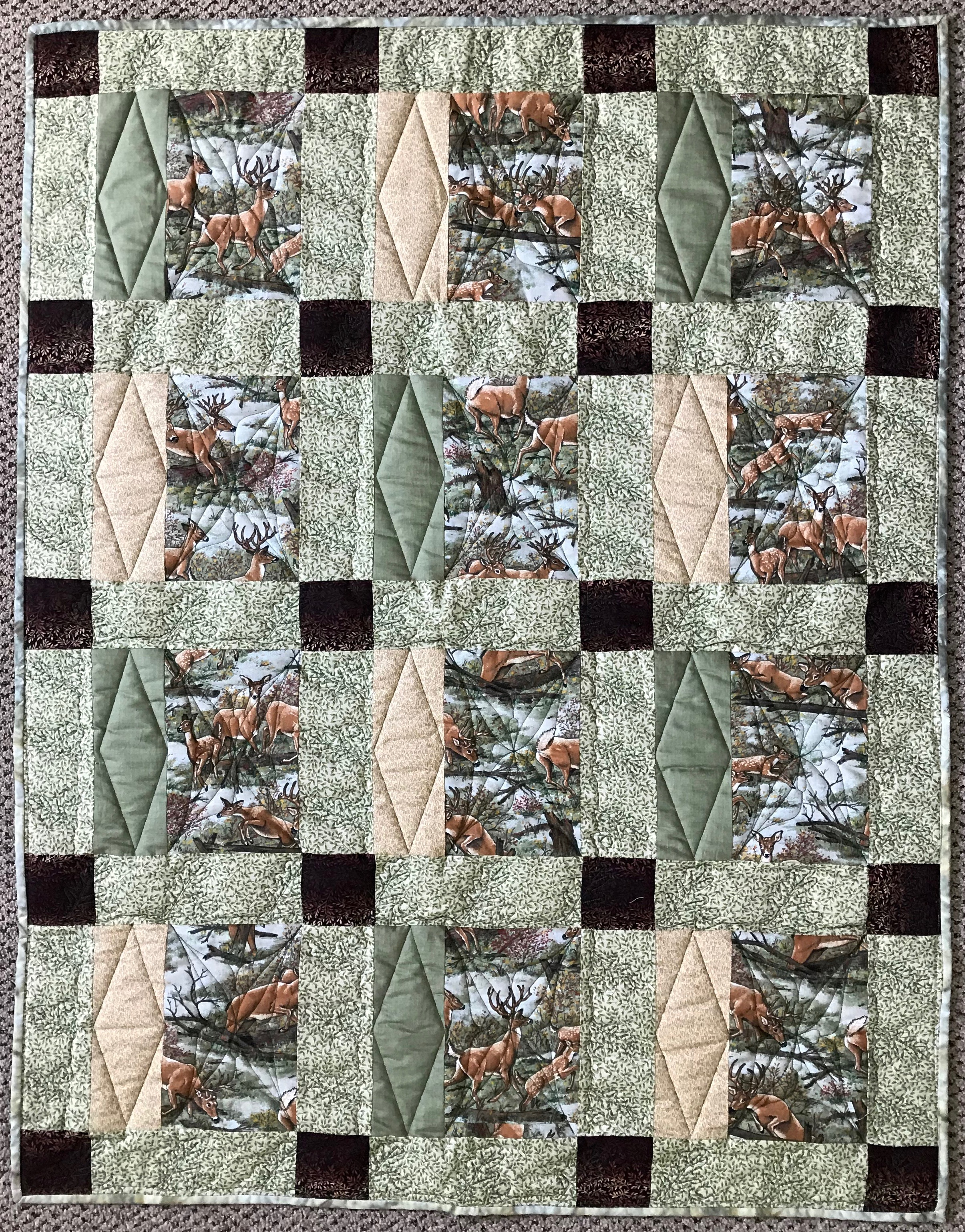 Deer in the Glen, Pieced, Machine Quilted, donated by Phyllis Schrag, 37 x 47