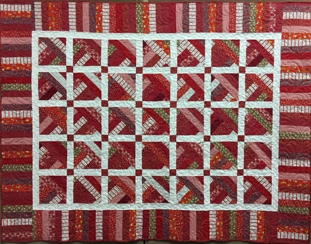 """Happy Scrappy Red Brick Road, Pieced by Colleen Stoltzfus, Edge to Edge Machine Quilted, donated by Silverwood Mennonite Women, 70 x 90"""""""