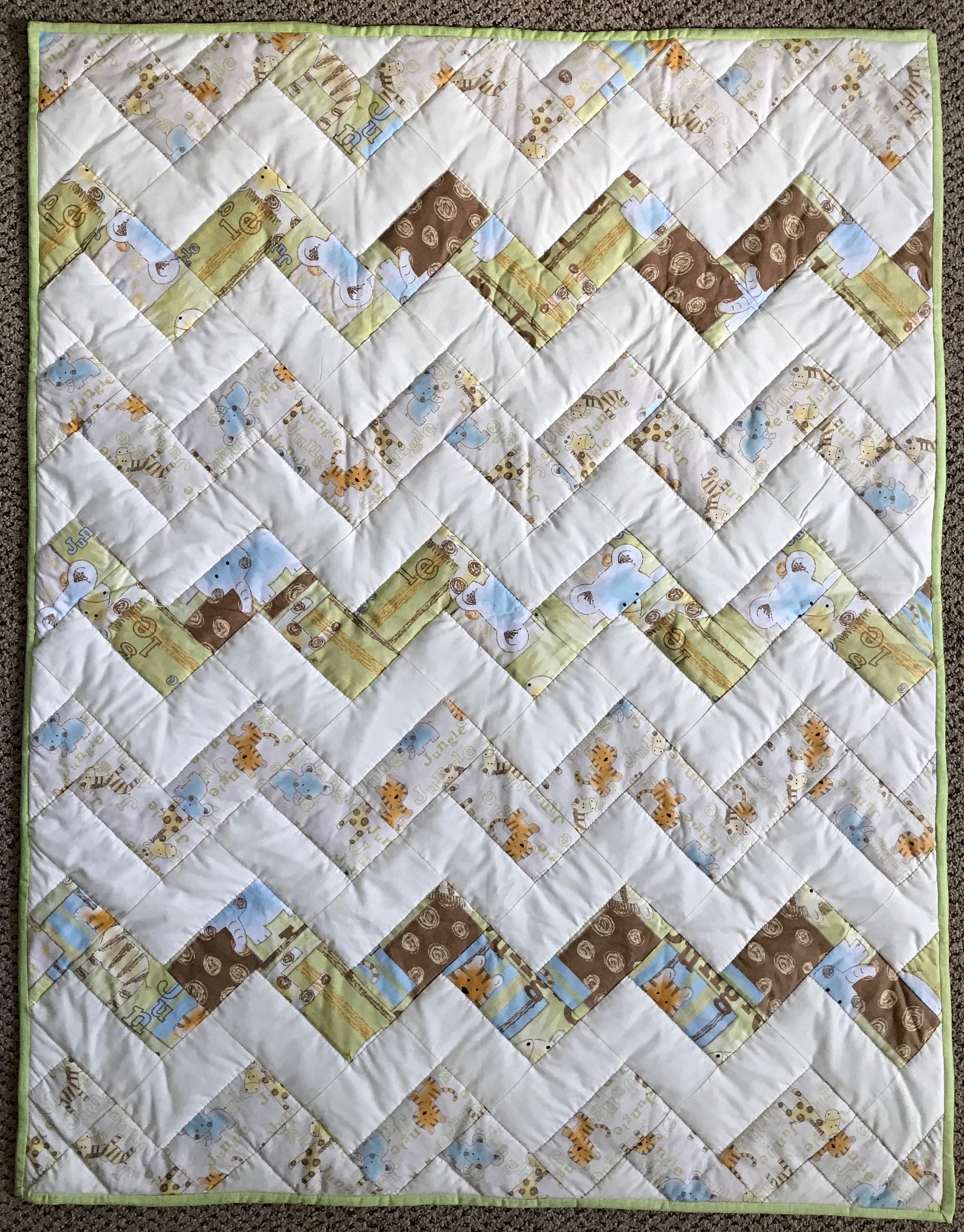 """Jungle Paths, Pieced, Hand Quilted, donated by Holdeman Mennonite Church, 36 x 46"""""""