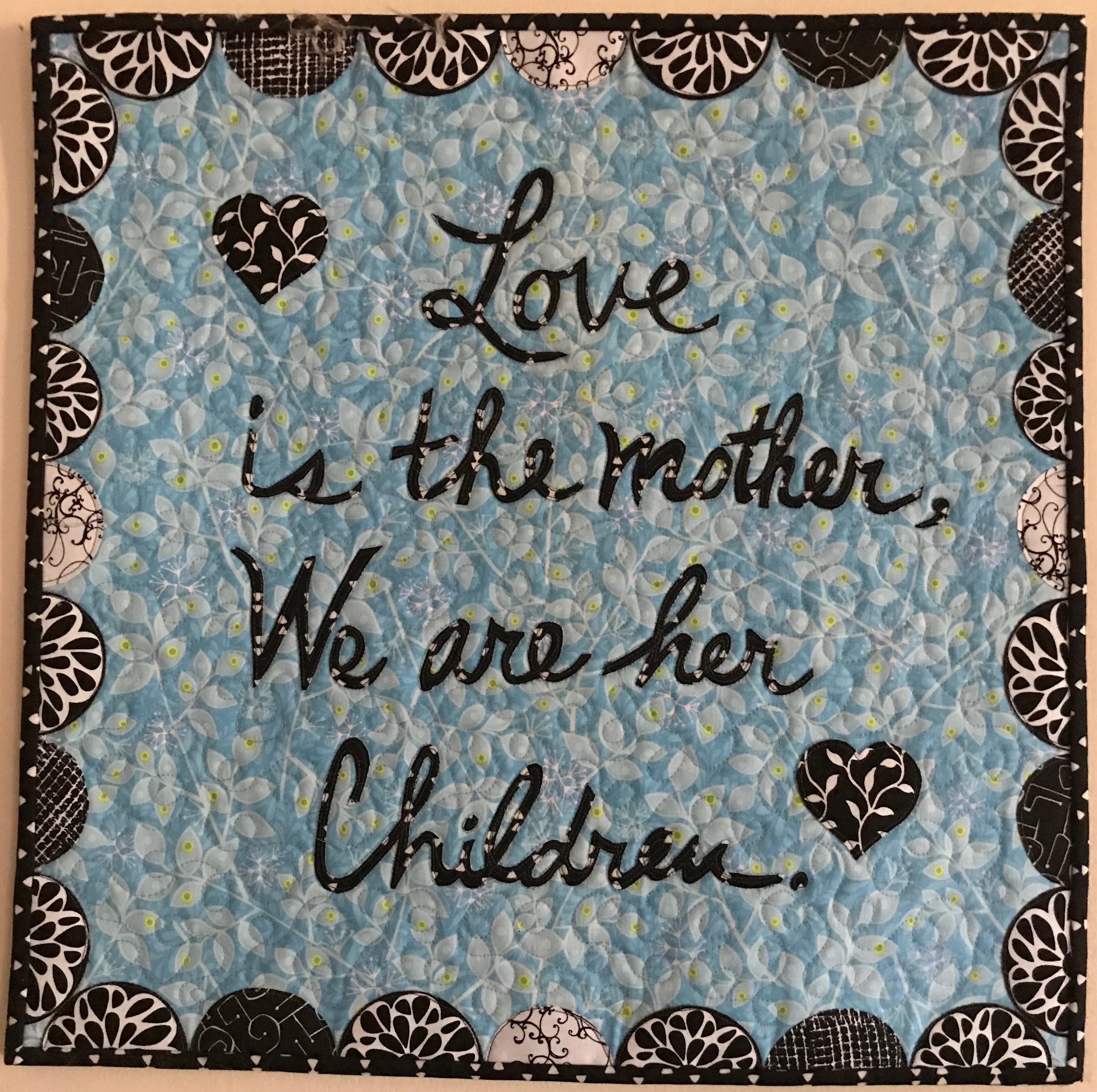 """Love is the Mother, Appliquéd, Custom Machine Quilted, donated by Pam Etheridge, 18 x 18"""""""