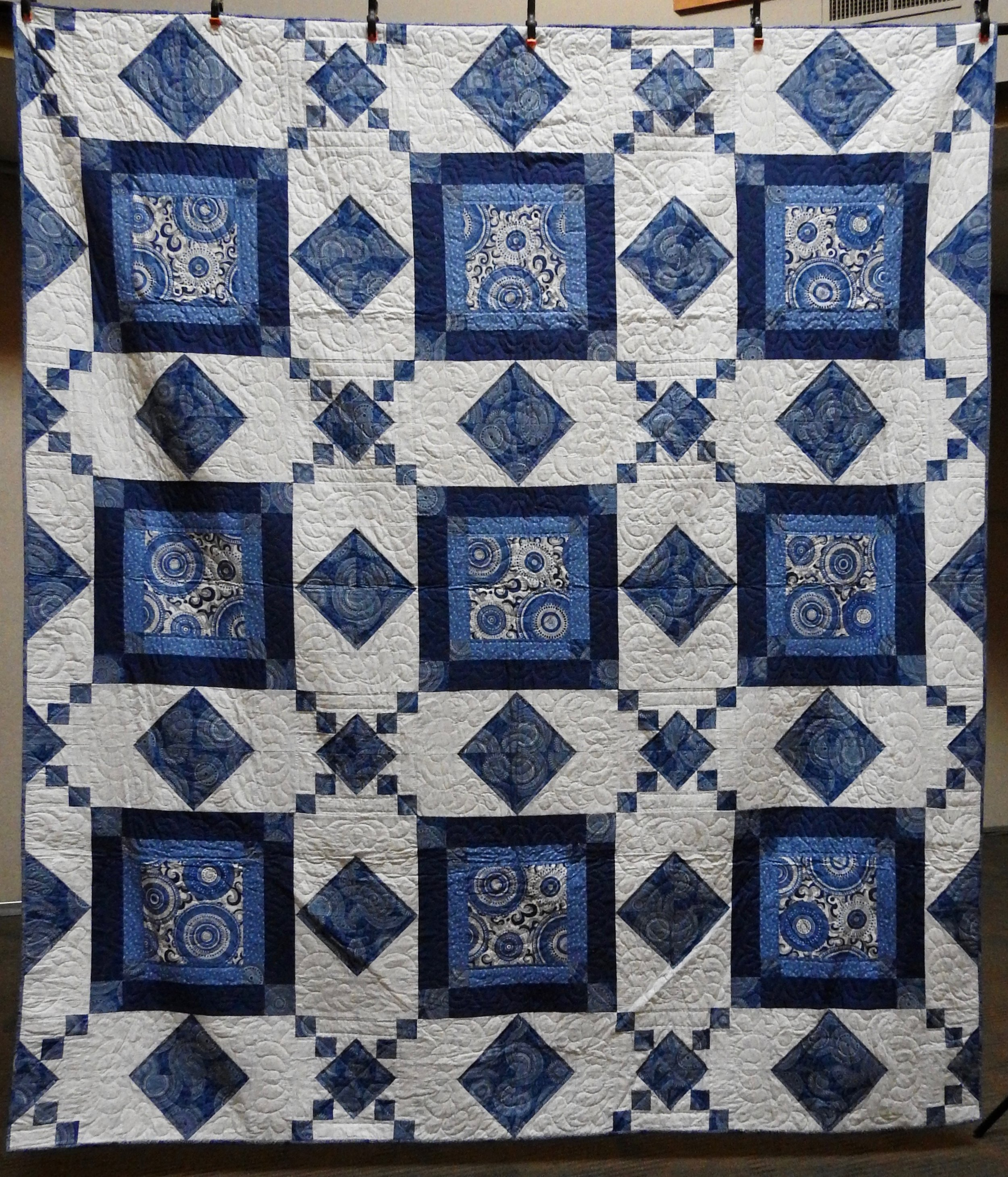 """Blue Swirl, Pieced by Linda Stenberg, Single Needle hand Quilted by Marilouise Hagenberg, donated by the Linda Stenberg Estate, 94 x 107"""""""