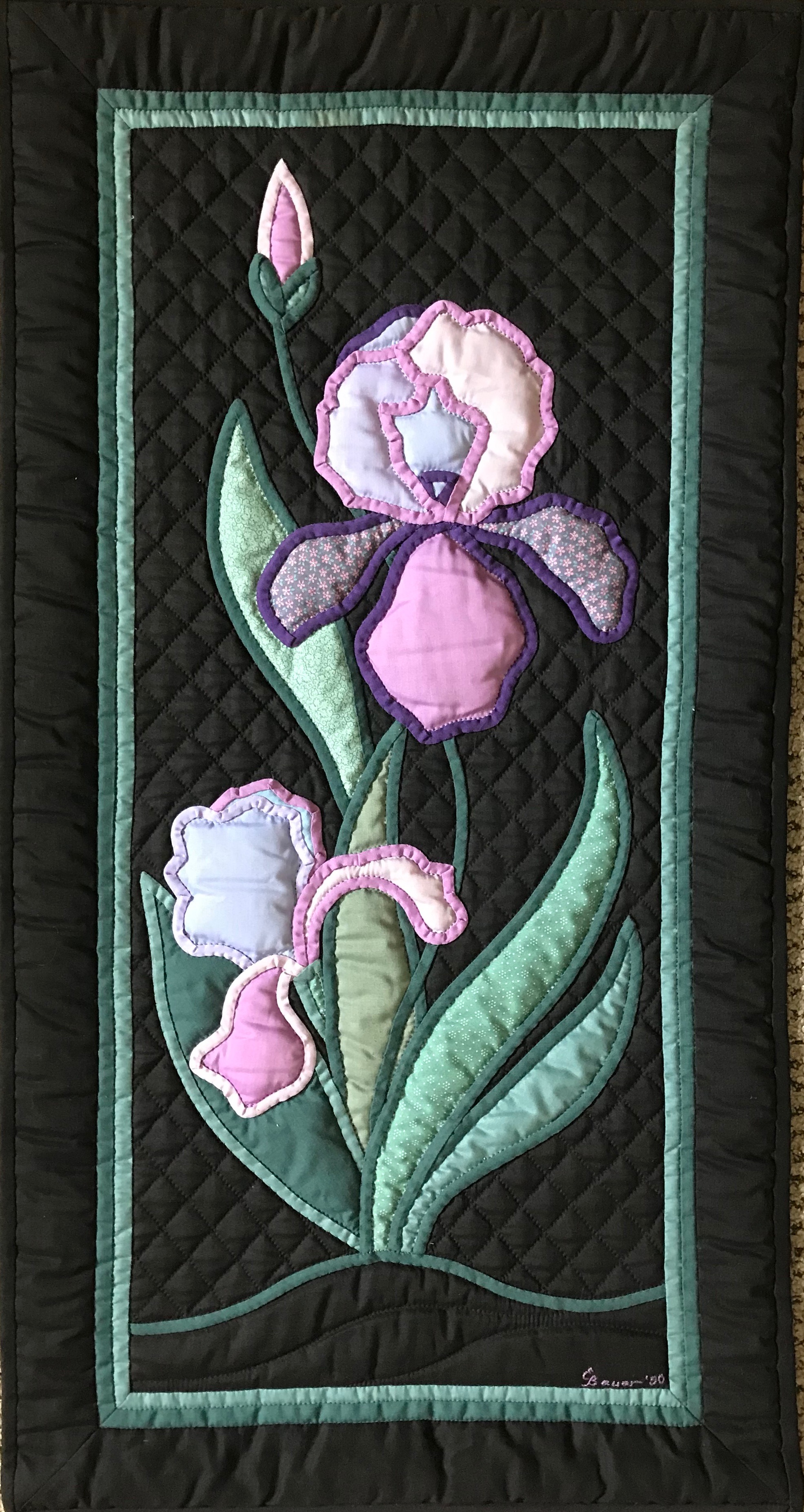 """Iris, Pieced, Appliquéd & Hand Quilted by Evelyn Bauer, donated by Steve McClain,17 x 32"""""""