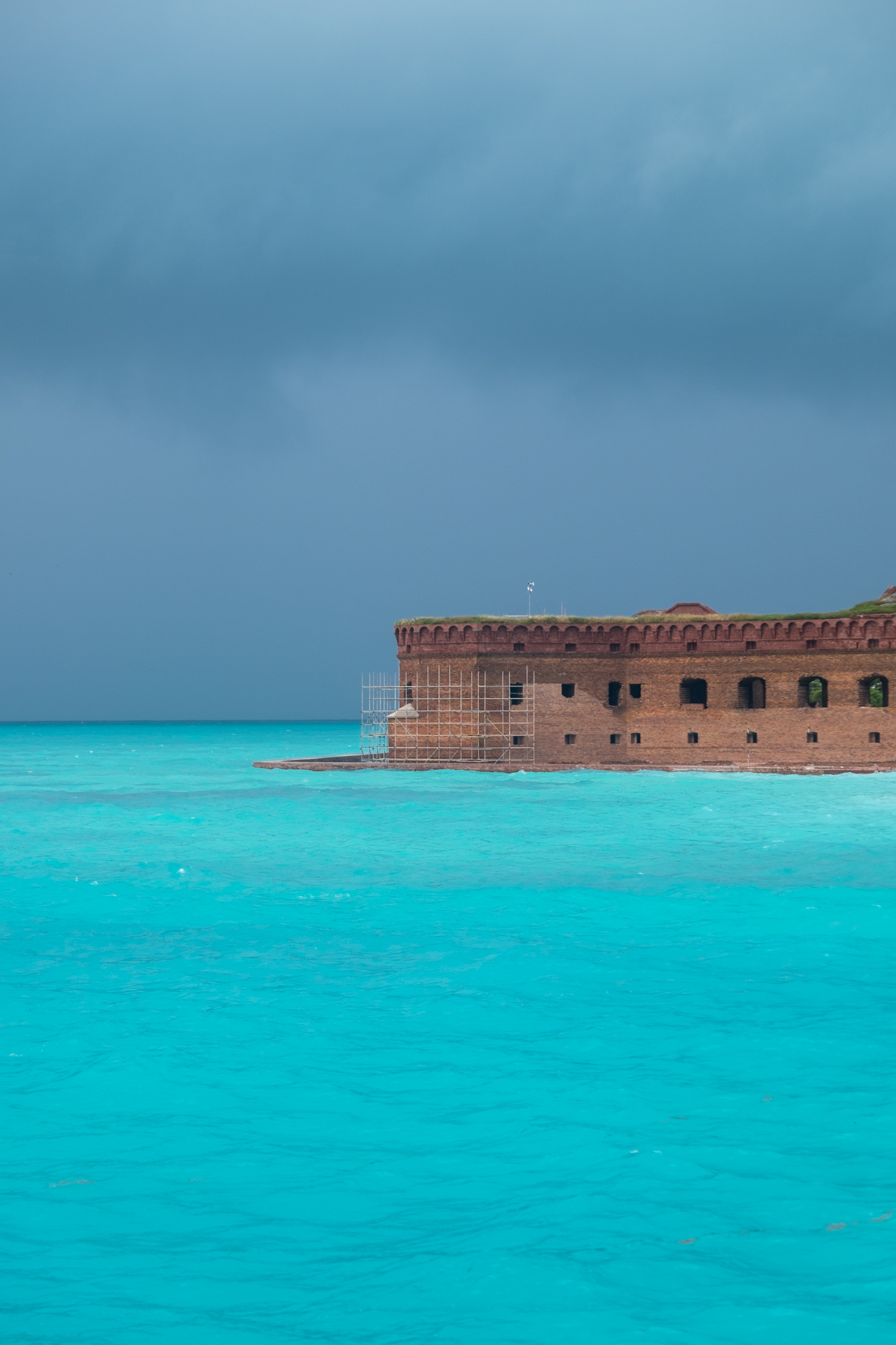 The fortress under stormy light.