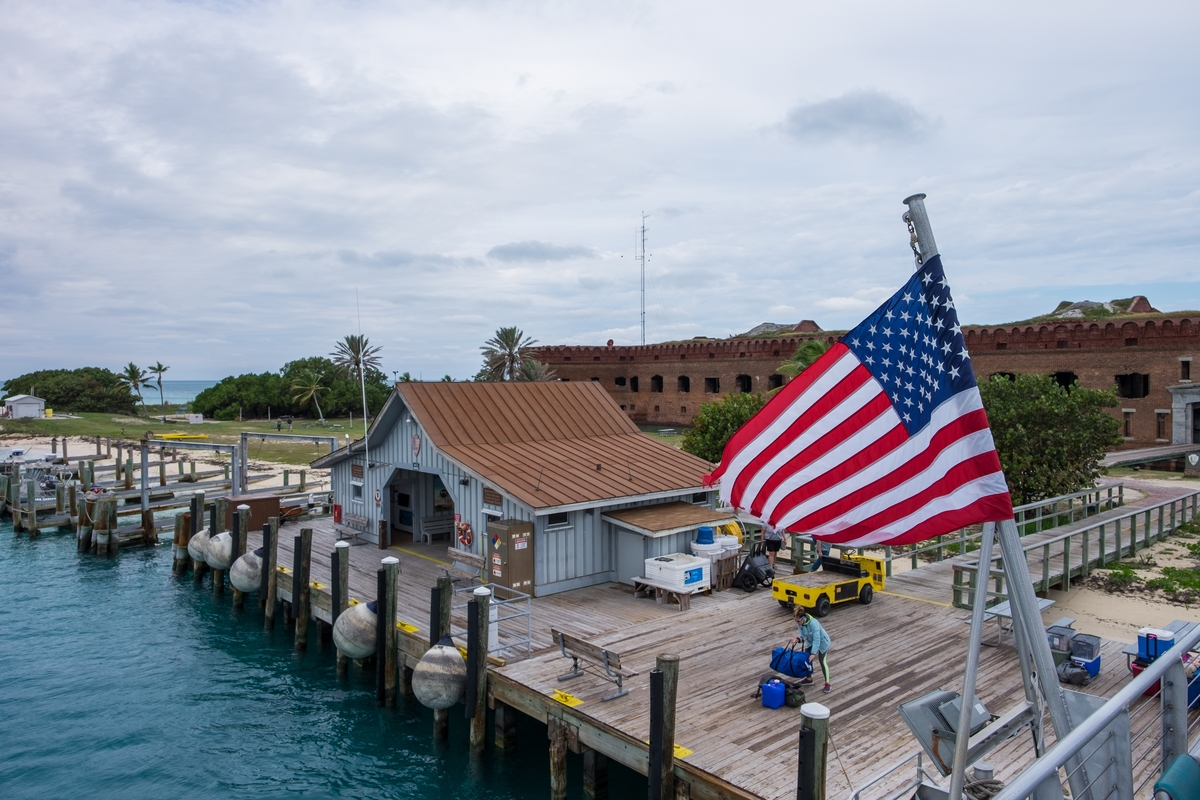 A flag waves above the harbor at Dry Tortugas National Park in Florida.