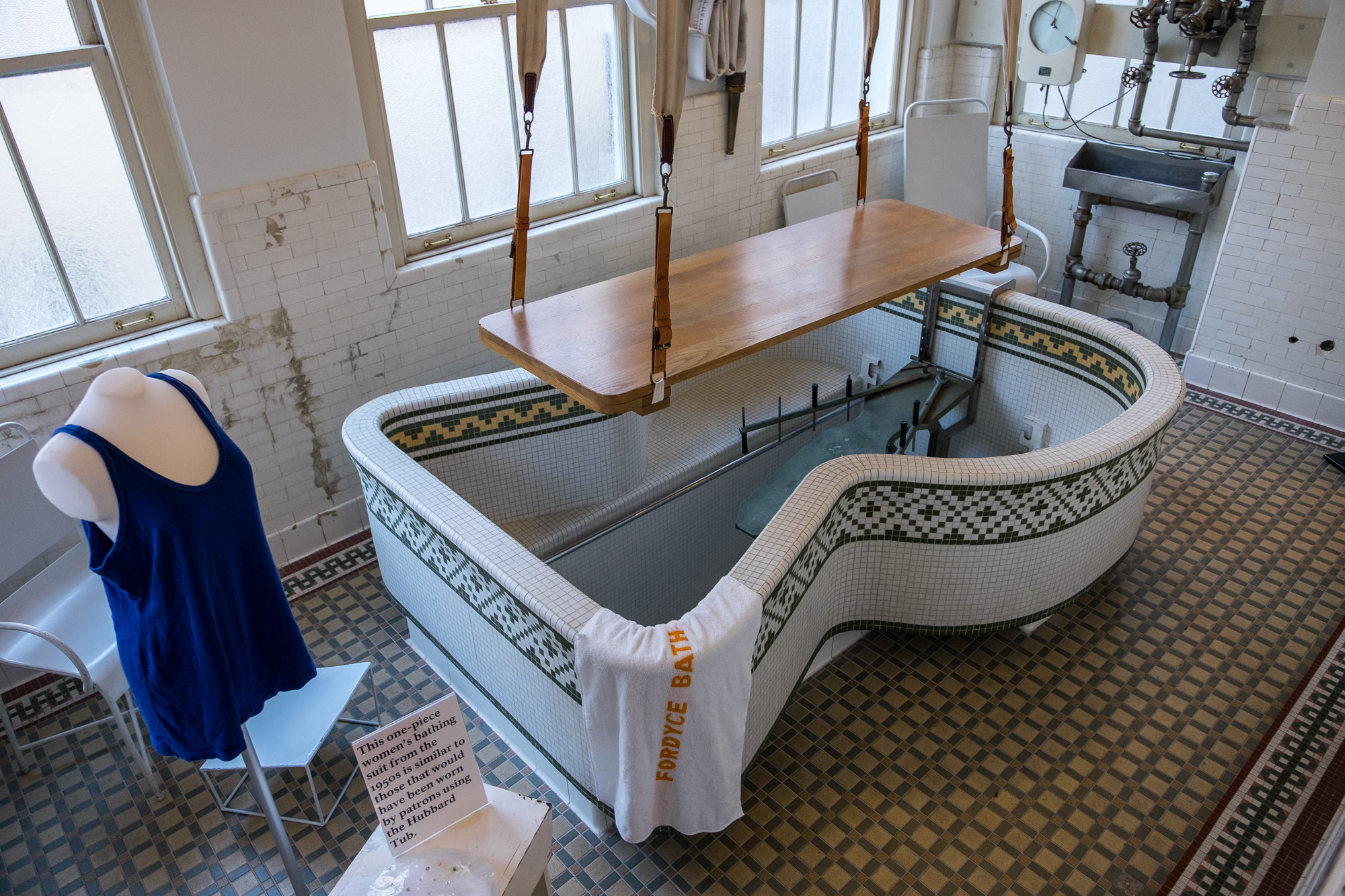 For special afflictions, this dipping bath was setup in a small room. People were brought  in on conveyer belts strung from the ceiling.