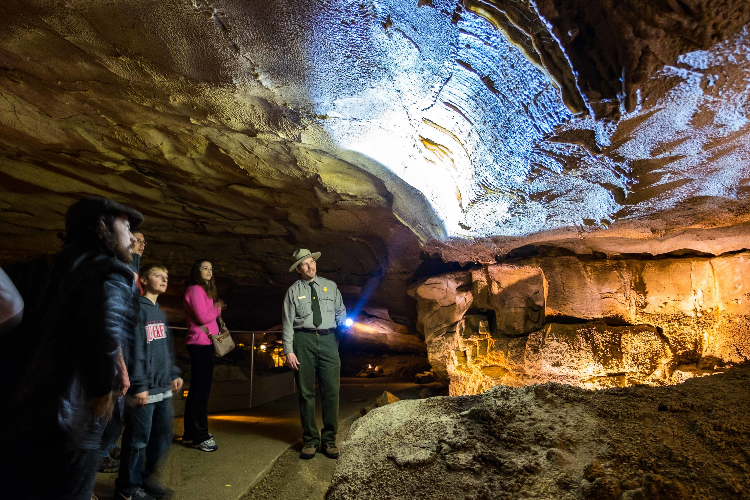 Ranger Jackie shows the group that there are indeed living bugs inside the cave.