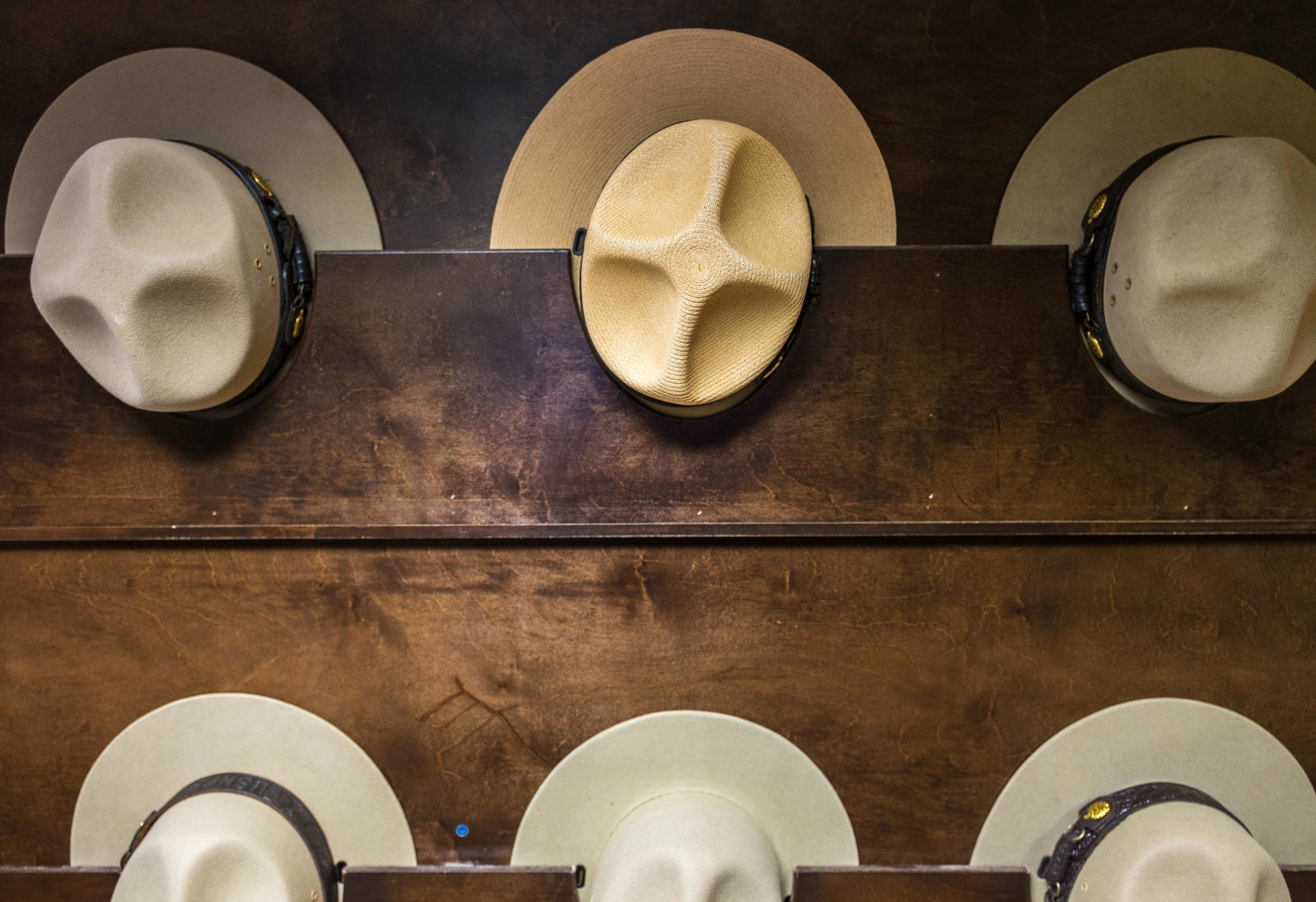 Before heading down in the cave we had a meeting with the rangers. We had hat-envy with this wall of Ranger hats.