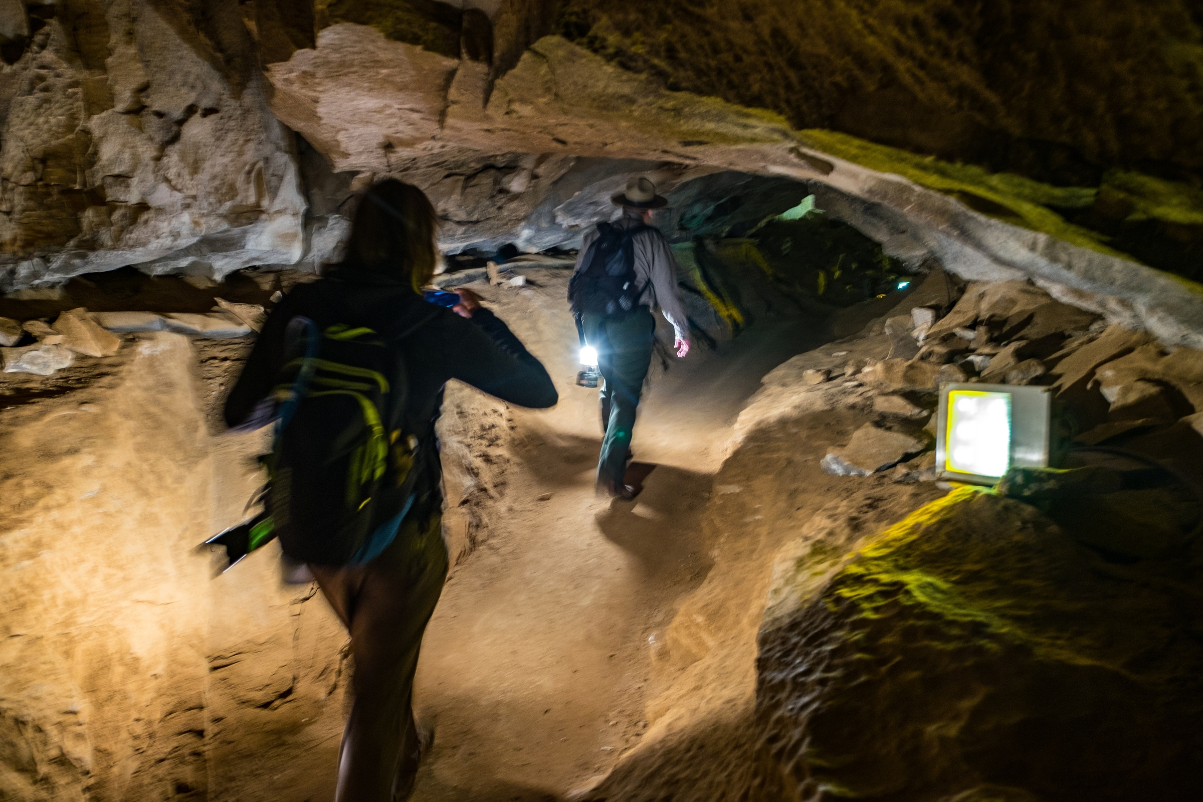 Stef follows Ranger Jackie as he leads the way into the cave.
