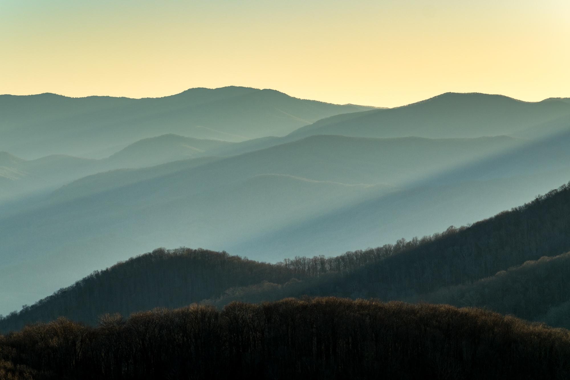 Sunlight streaks through the mountains.