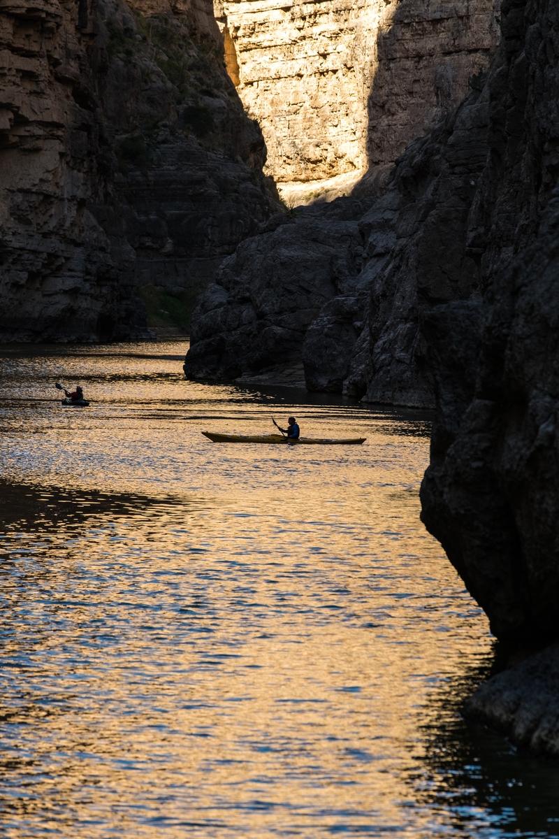 Kayakers explore the Rio Grande from the Santa Elena trailhead.