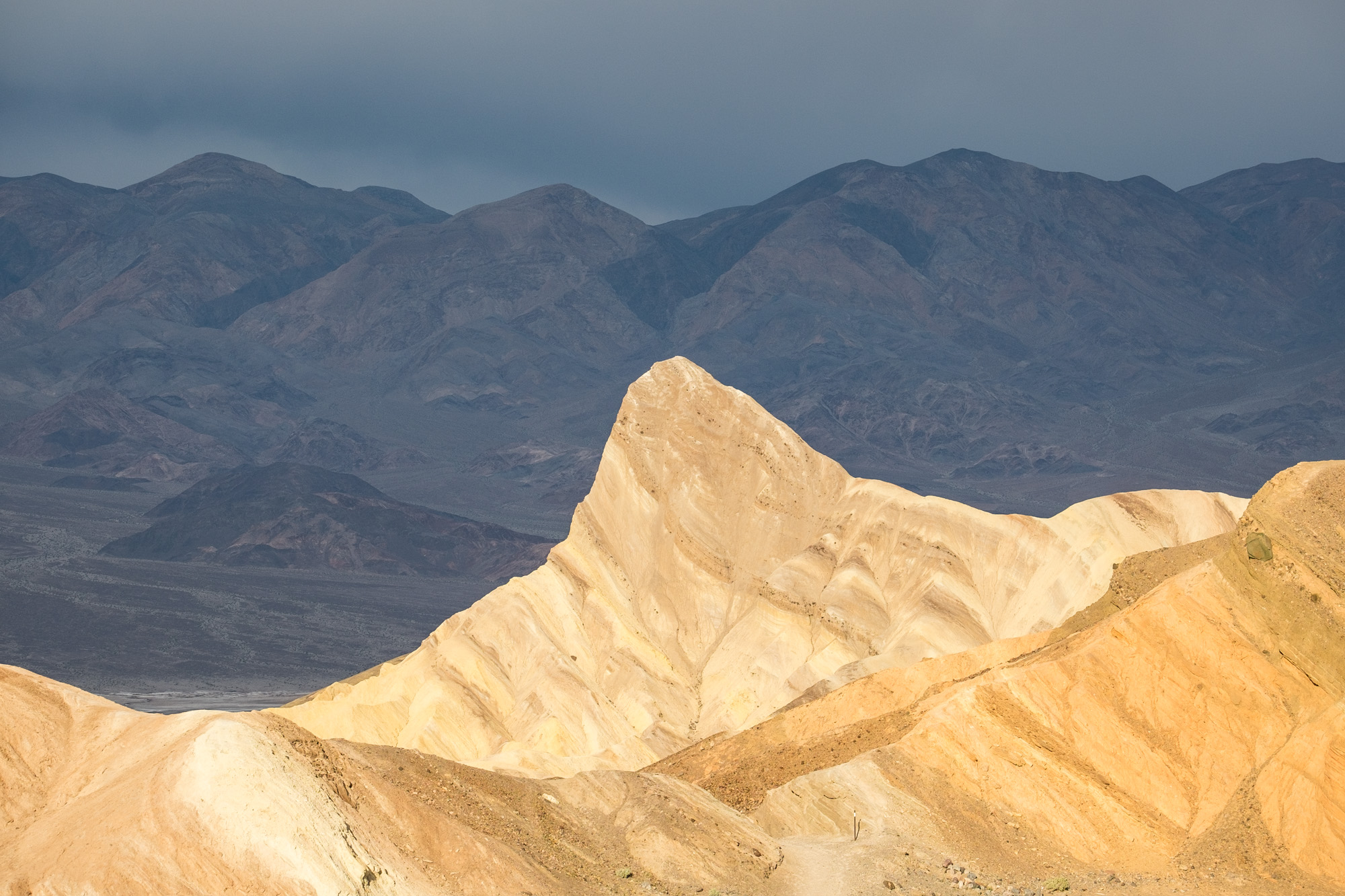 The famous peak that is lit up golden tan/yellow during sunrise at Zabriskie Point.