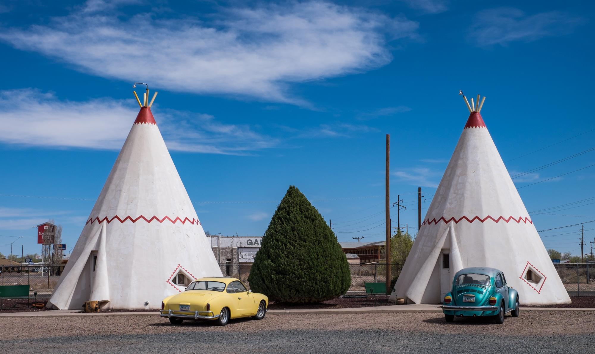 Old cars help make the strange teepee shaped hotel rooms even stranger.